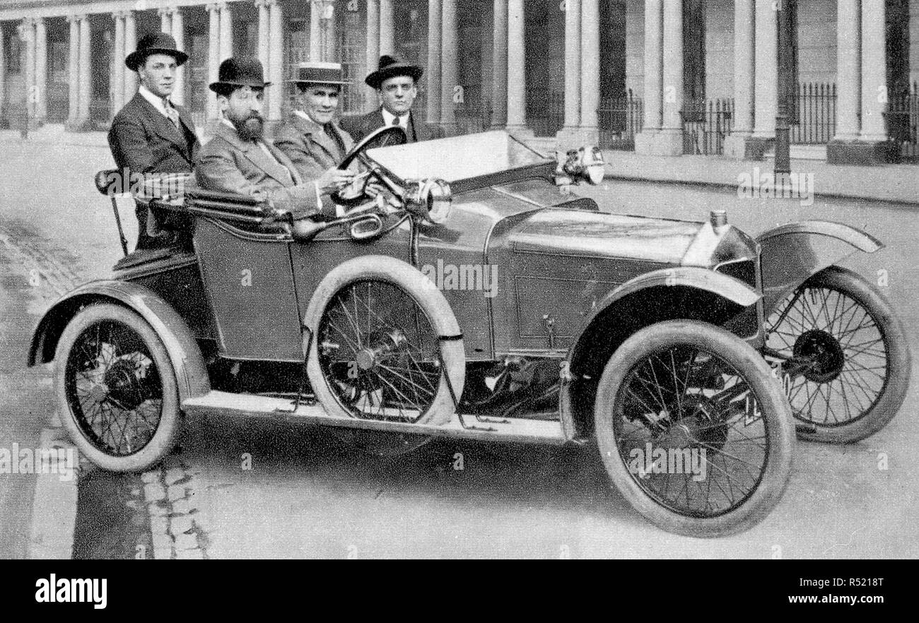 1914 - A private three seater motor car of the time with an additional 'rumble' pillion seat - Stock Image