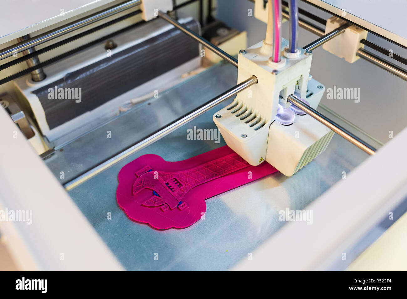 Close Up of 3D printer while printing screw wrench or screw spanner. 3D printing in progress. New generation of 3D Printing Machine. For use in small  - Stock Image