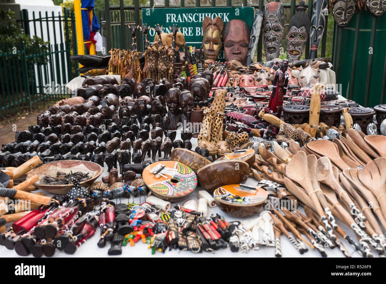 table displaying African curios or souvenirs for sale at street market in Franschhoek, Cape Town - Stock Image