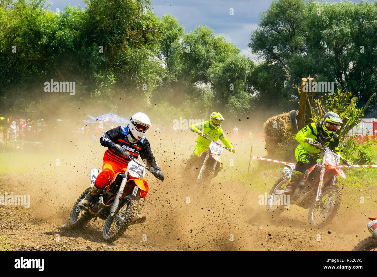 Uzhgorod, Ukraine - JUN 26, 2018: TransCarpathian Open Regional Motocross Championship. extreme sport competition. participants accelerating after sta - Stock Image
