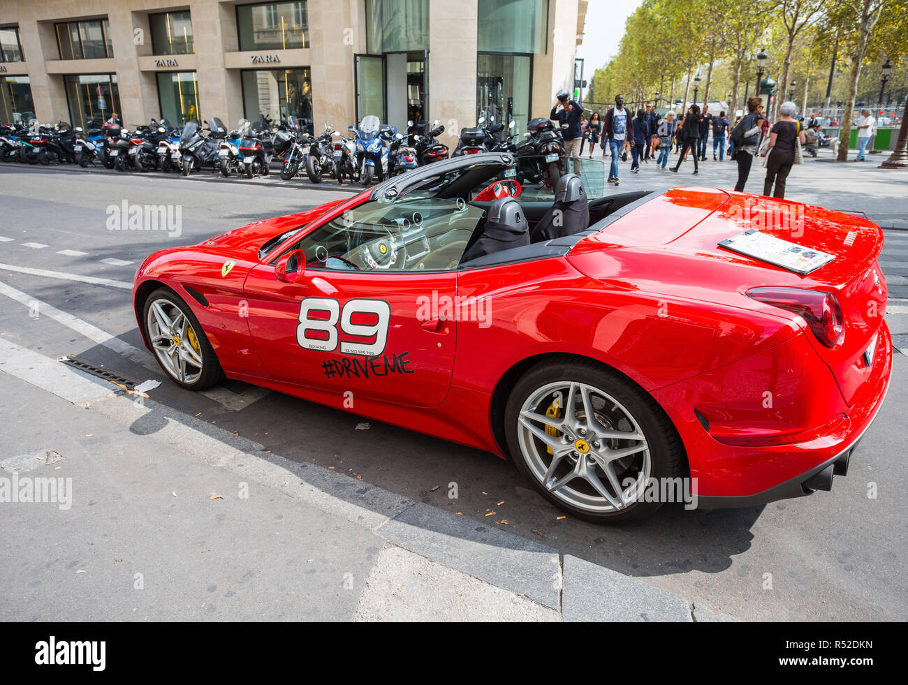 PARIS, FRANCE, SEPTEMBER 5, 2018 - Ferrari California luxury coupe sports car rental along the Champs-Elysee. Travel and tourism. - Stock Image