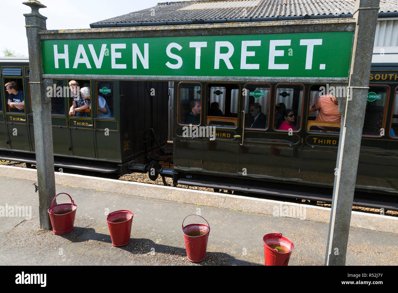 Third 3rd class train carriage on the historic Isle of Wight steam Railway line, seen with Havenstreet Main Road, Haven street station sign. - Stock Image