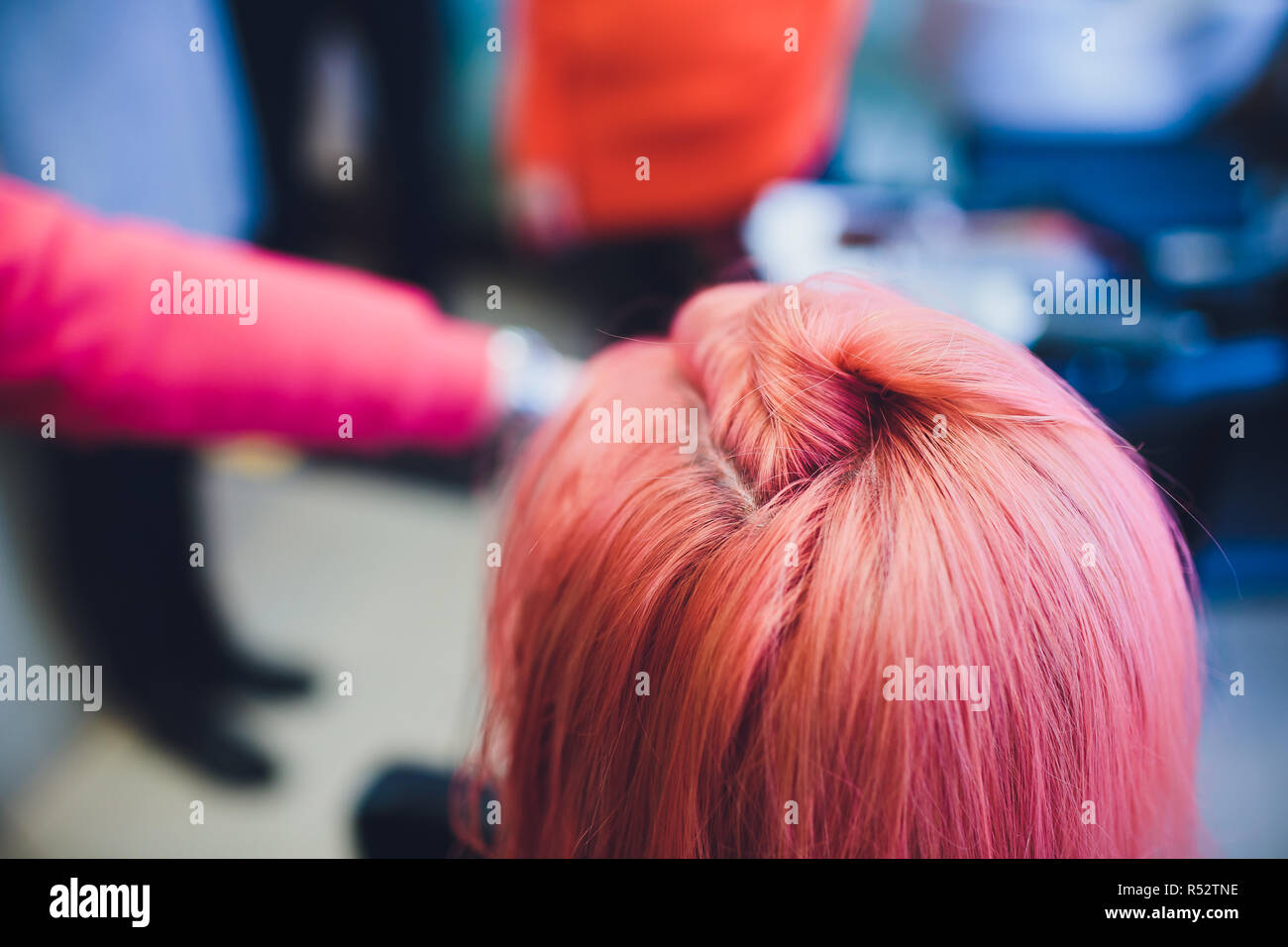 Painting red of hair in a beauty salon. - Stock Image