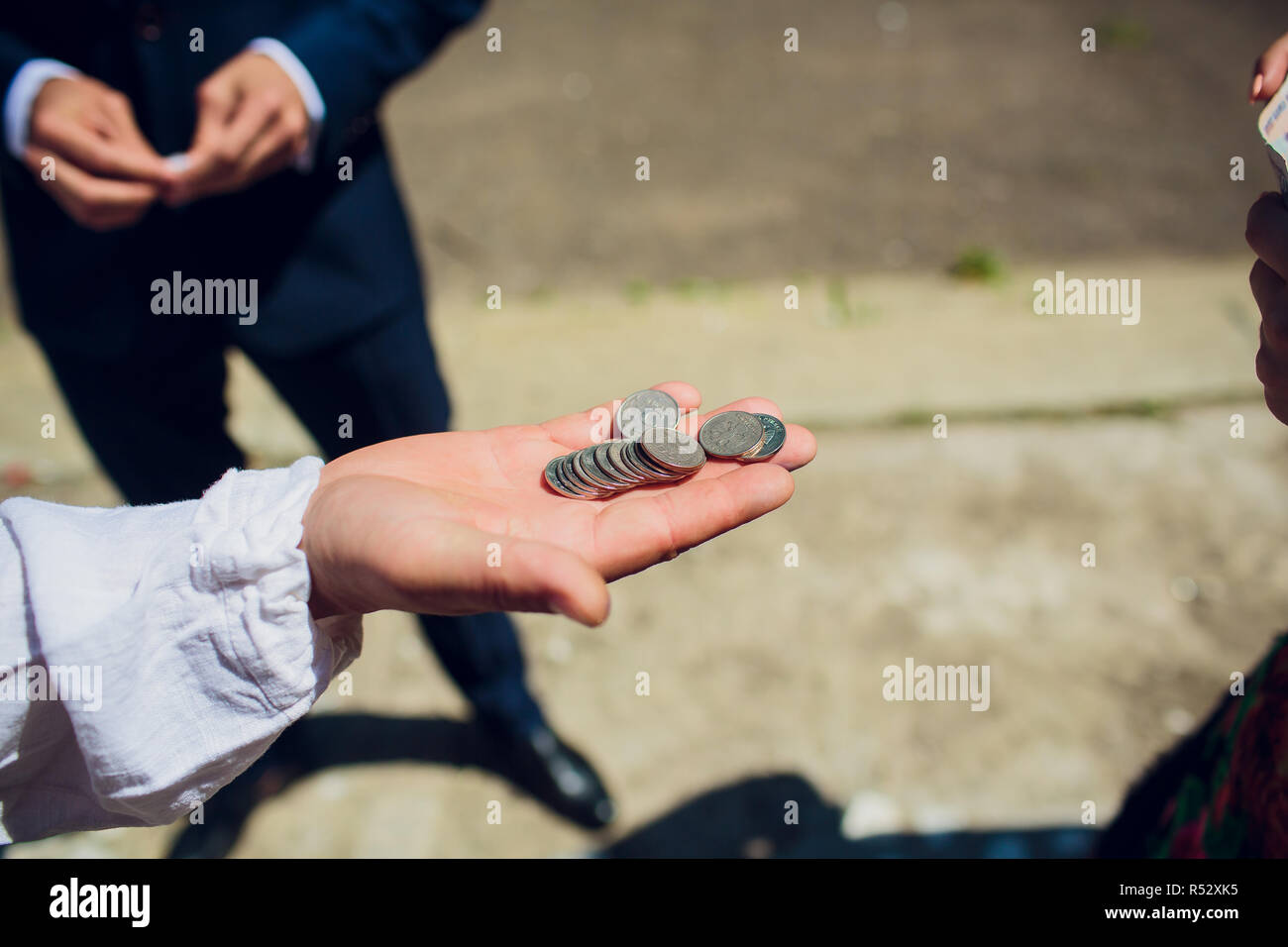 Hand injured bloody finger holds banknote grey background. Dirty money concept. Bloody currency. Money covered with traces of crime. Handover criminal profit. Dollar marked by murder. - Stock Image