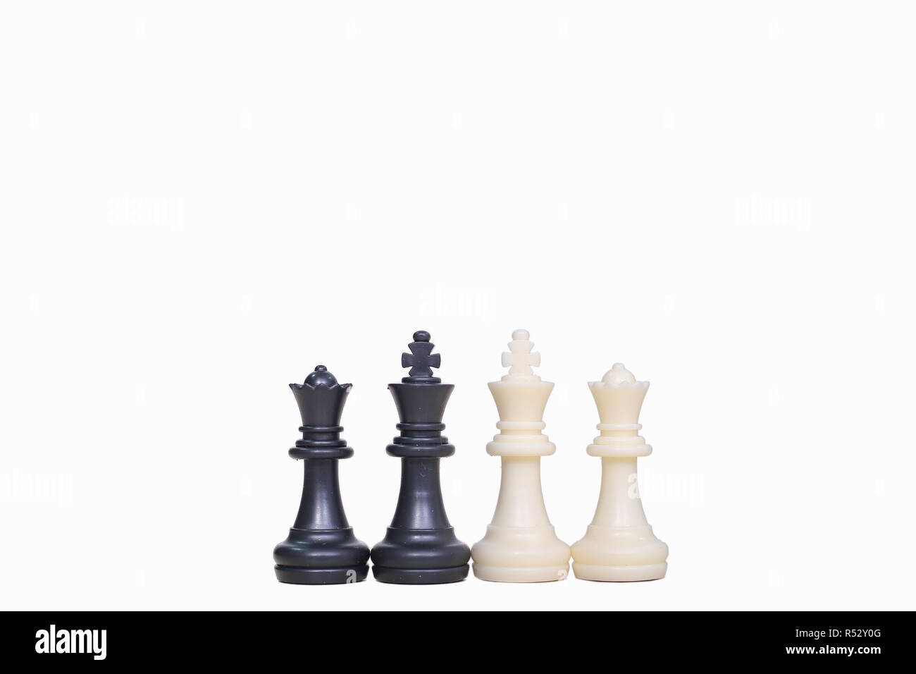 Picture of chess pawns on the white background. - Stock Image