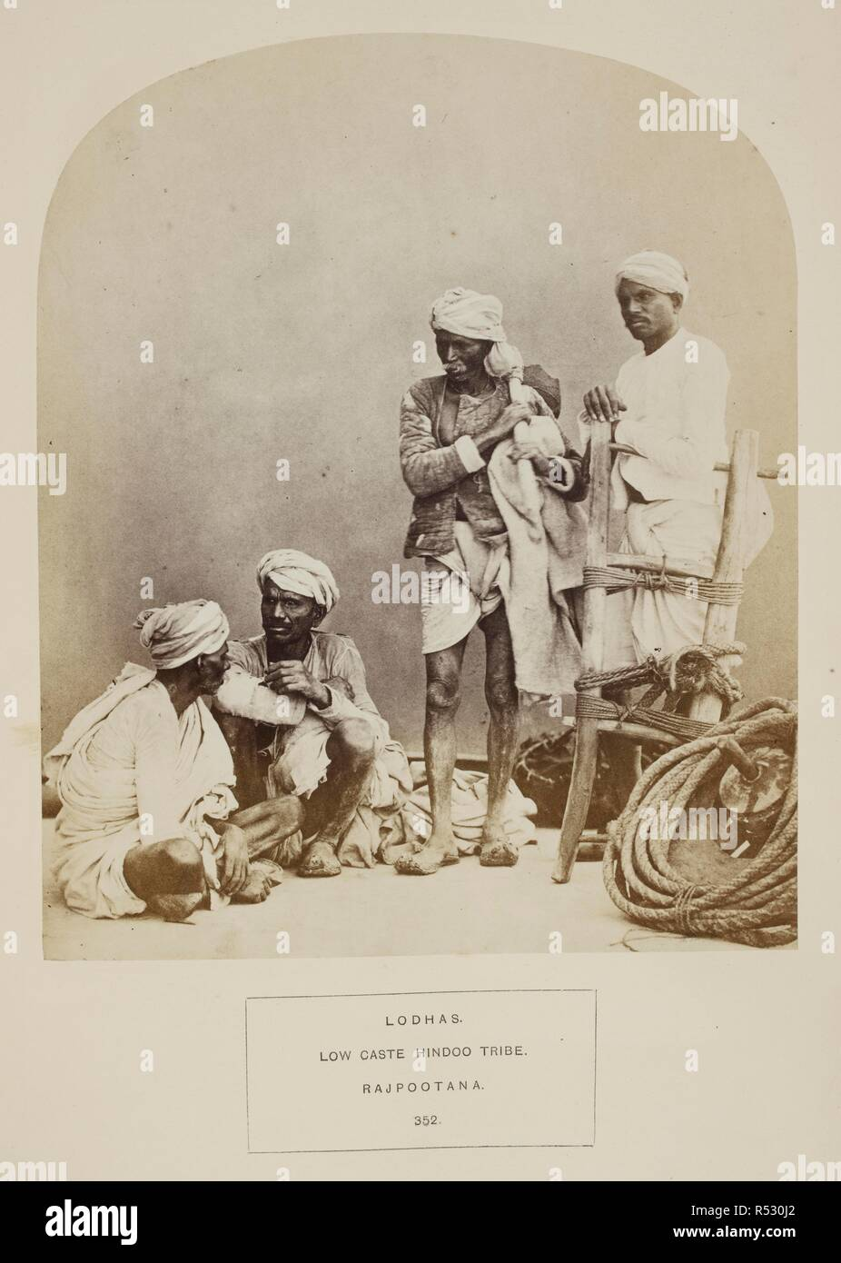 Lodhas. Low caste Hindoo tribe. Rajpootana. A group of four men with agricultural implements. J. Forbes Watson and John William Kaye, 'The People of India. A series of photographic illustrations, with descriptive letterpress, of the races and tribes of Hindustan. Volume VII' (India Museum, London, 1872). 1862. Photograph. Source: Photo 972/7(352). Language: English. Author: Shepherd and Robertson. - Stock Image