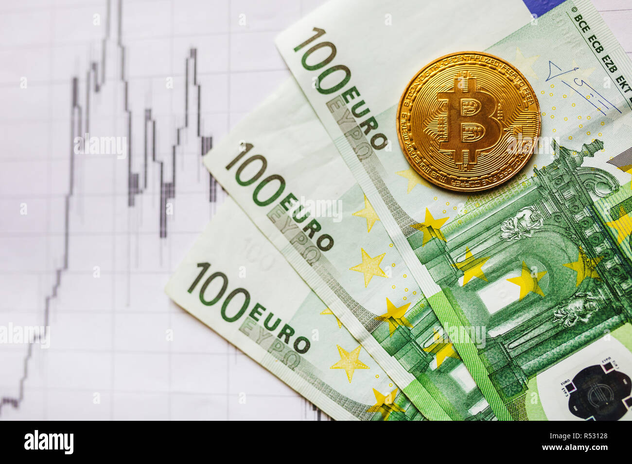 virtual money golden bitcoin on hundred euro bills and on paper