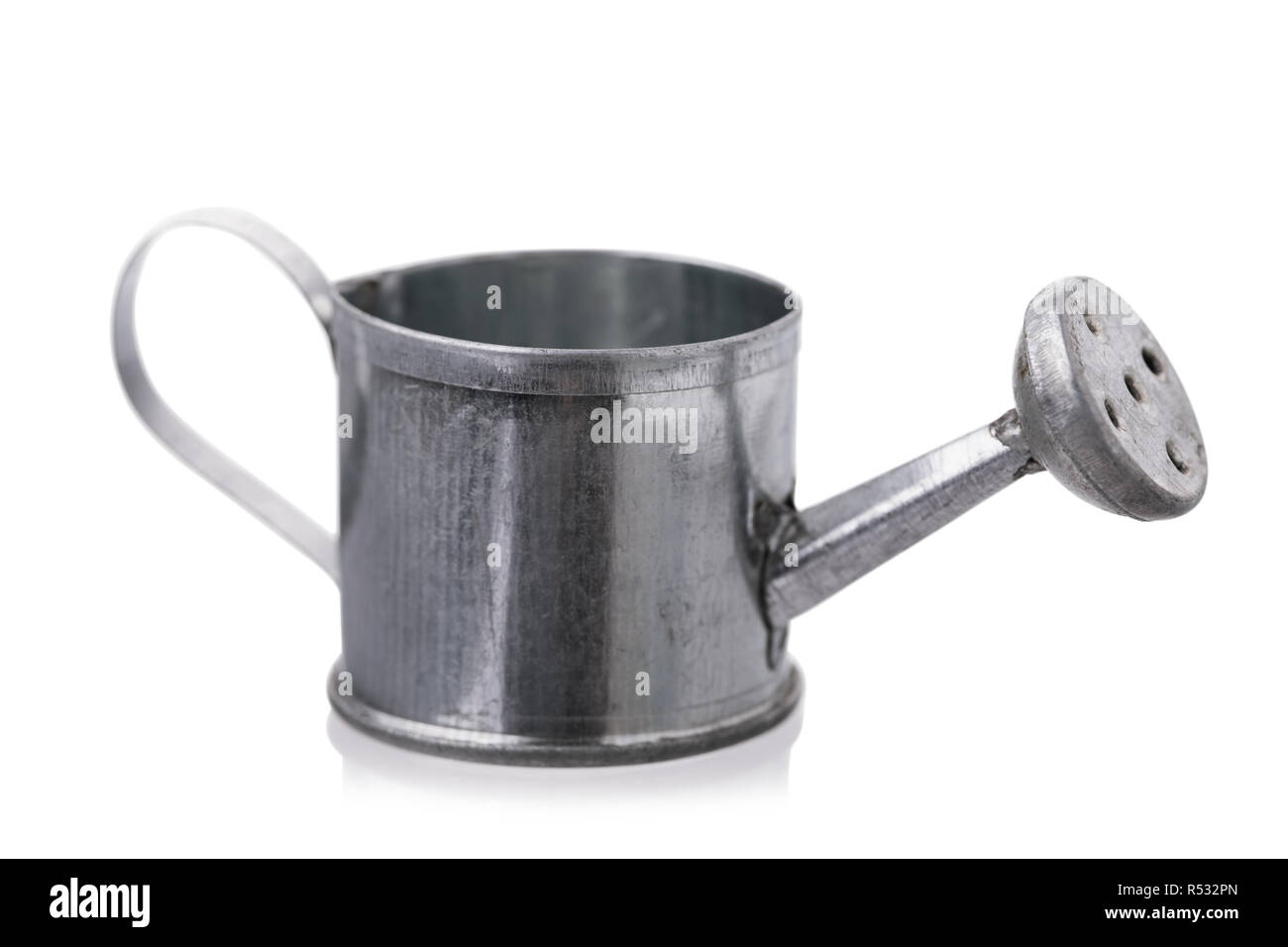 Metal watering can isolated on a white background - Stock Image