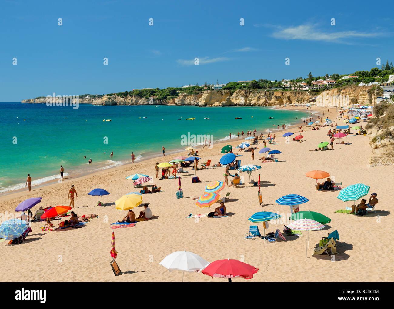 Armacao de Pera beach with sunshades - Stock Image