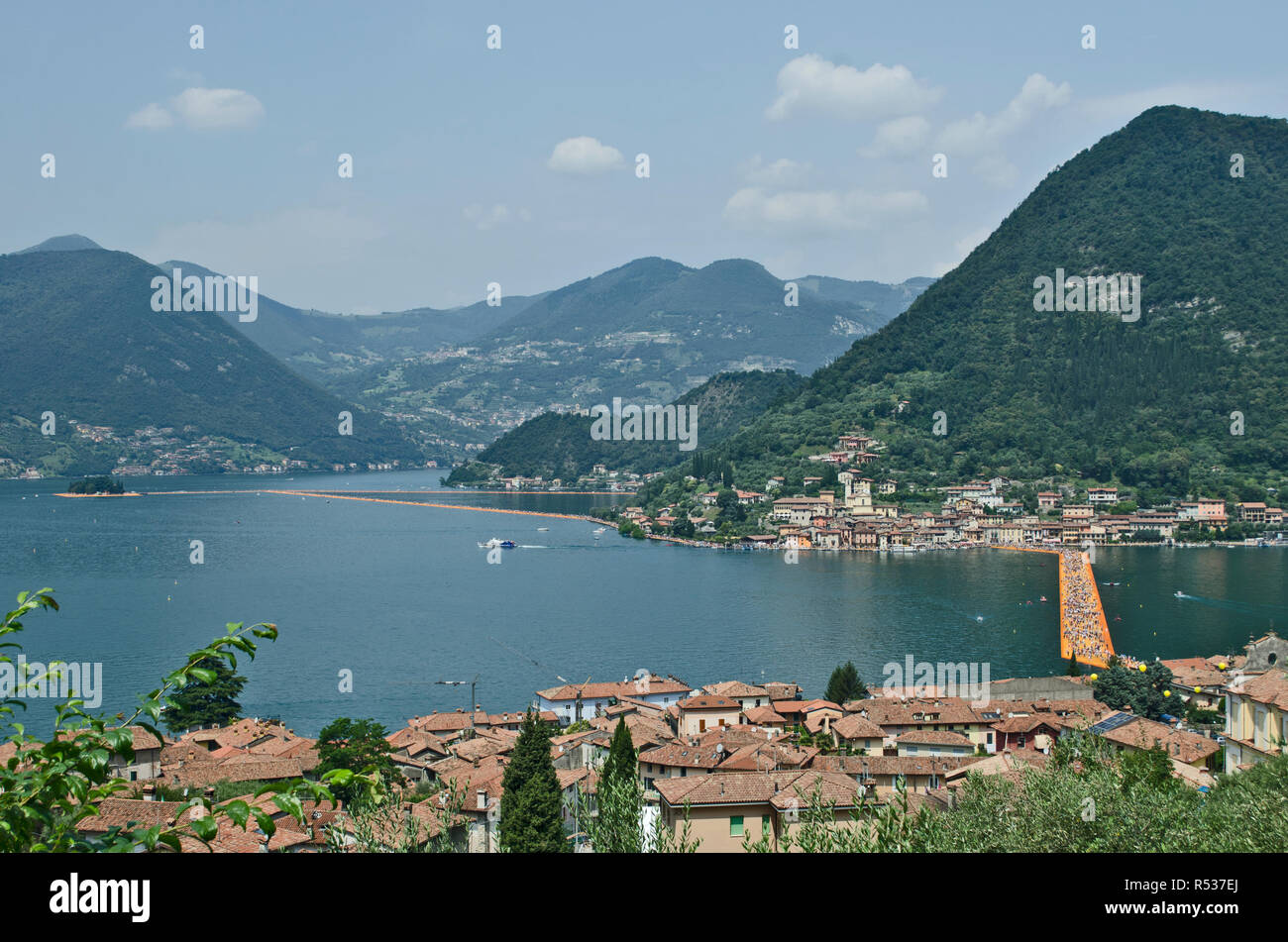 The Floating Piers by Chisto and Jeanne Claude, on Iseo lake between Sulzano e Monte Isola in Italy. It was on site fron June 18th to July 3rd, 2016 - Stock Image