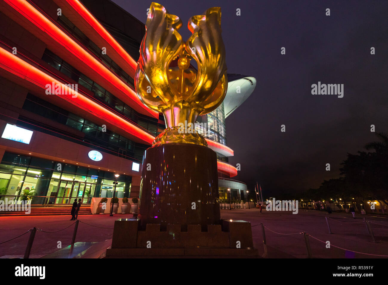 Night view of Golden Bauhinia Square. The statue was built to mark the 1997 handover from Britain to China. Hong Kong, Wan Chai, January 2018 - Stock Image