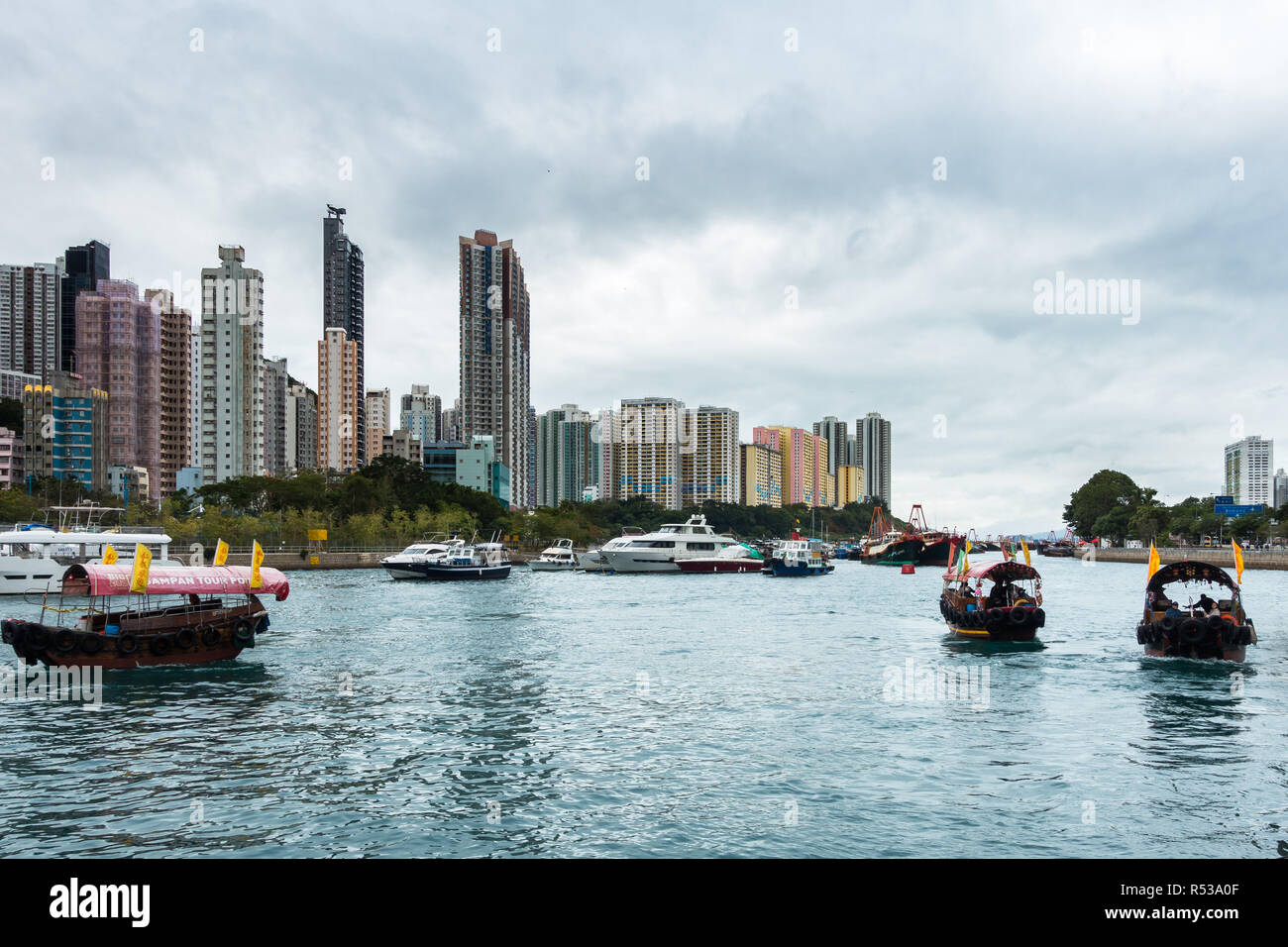 Sampan ride is a popular tourist activity to explore Aberdeen habour and the floating village where people live on house boats, Hong Kong Stock Photo