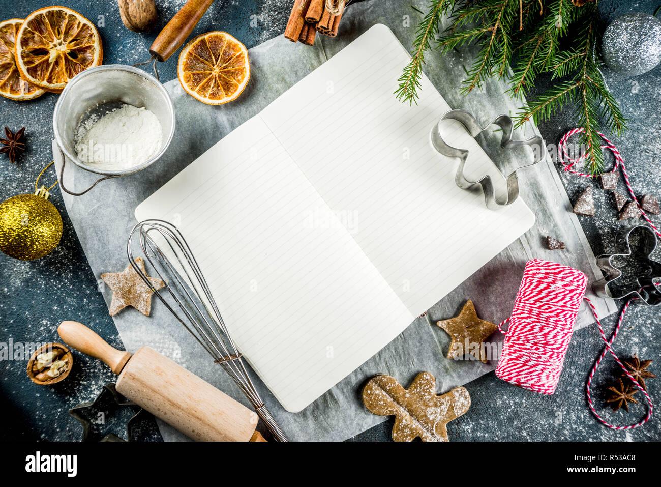 Empty Cookbook For Christmas Recipes On Dark Blue Concrete