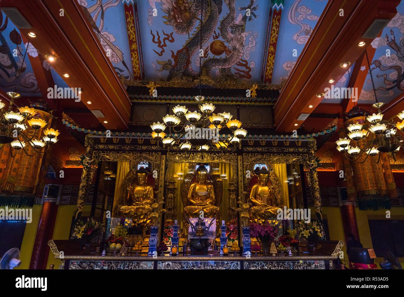 Golden Buddha statues and altar in the Main Shrine Hall of Po Lin Monastery. Hong Kong, Ngong Ping, Lantau Island, January 2018 Stock Photo