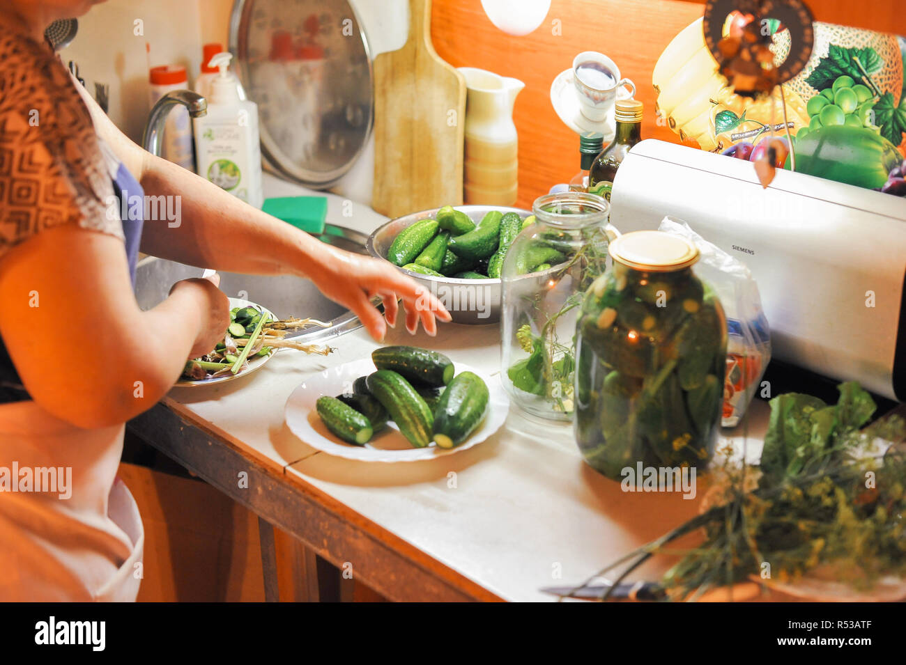 People Are Preparing In The Kitchen Pickling Cucumbers Preparation