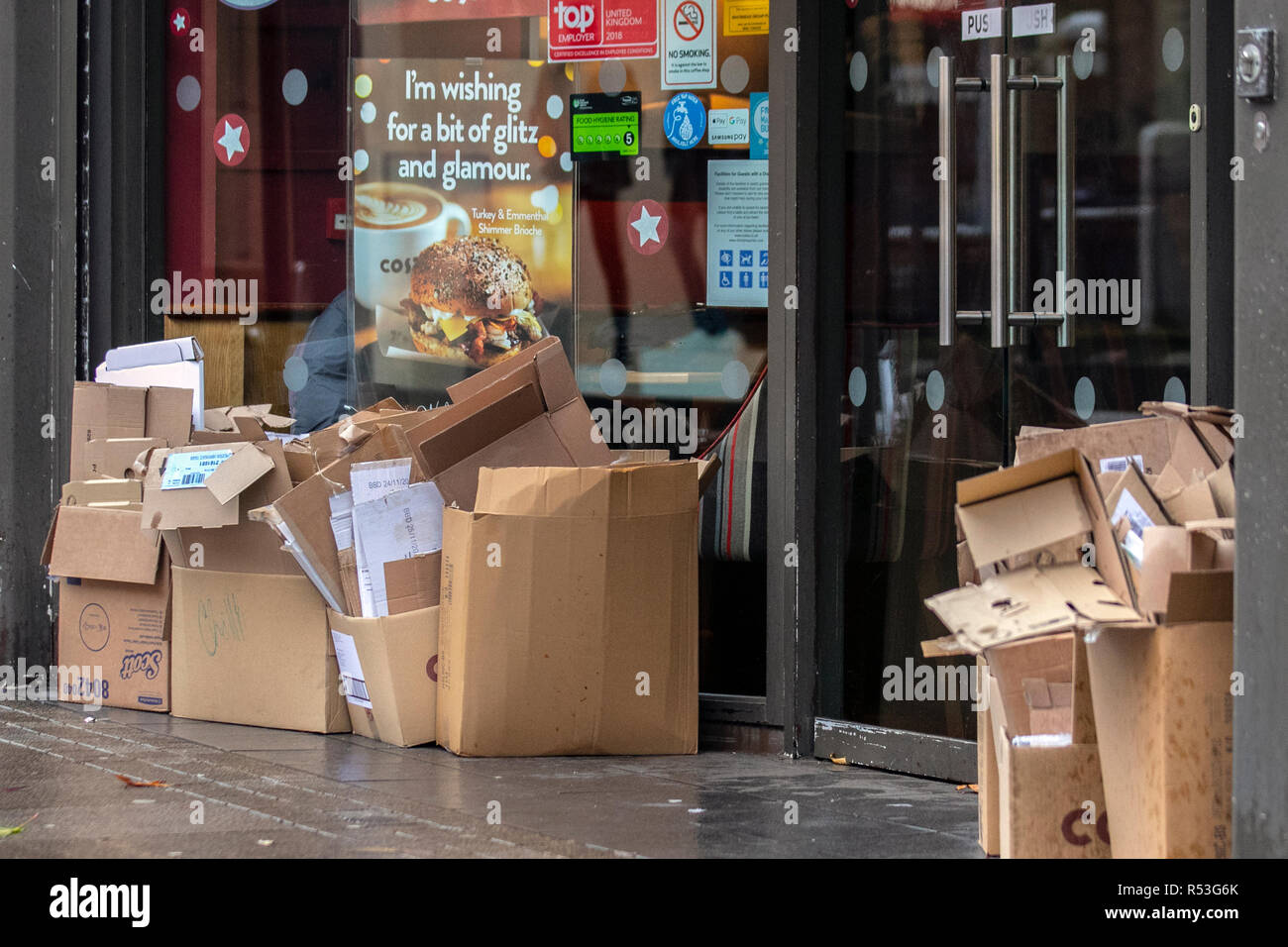 Coffee shop reycyling disposable cardboard containers, merchandise, sale, empty folded boxes, Preston, UK - Stock Image