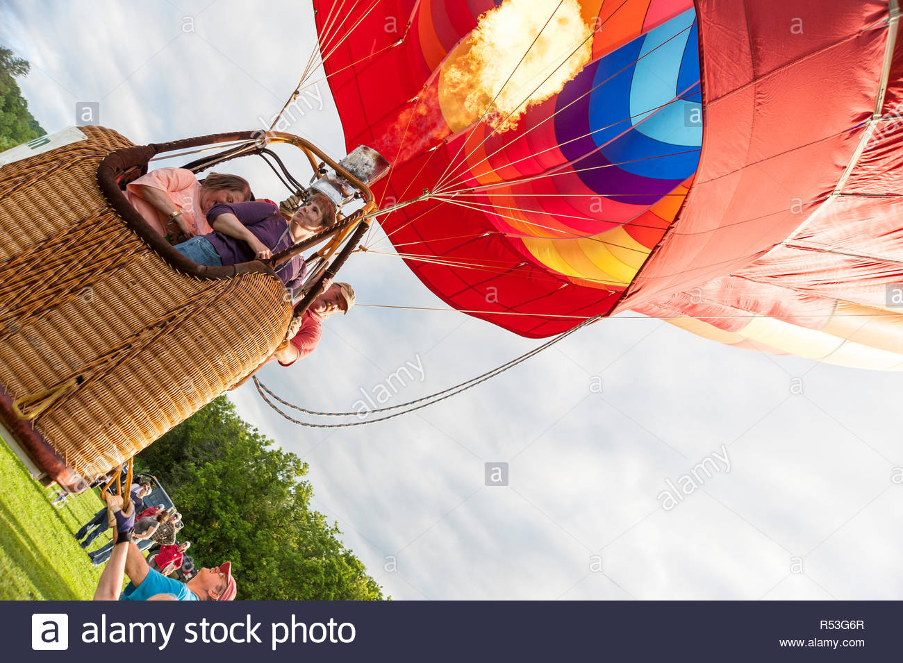 Quechee, Vermont, USA - June 19, 2009: Hot air balloon lifts off at the Quechee Hot Air Balloon Craft and Music Festival Stock Photo