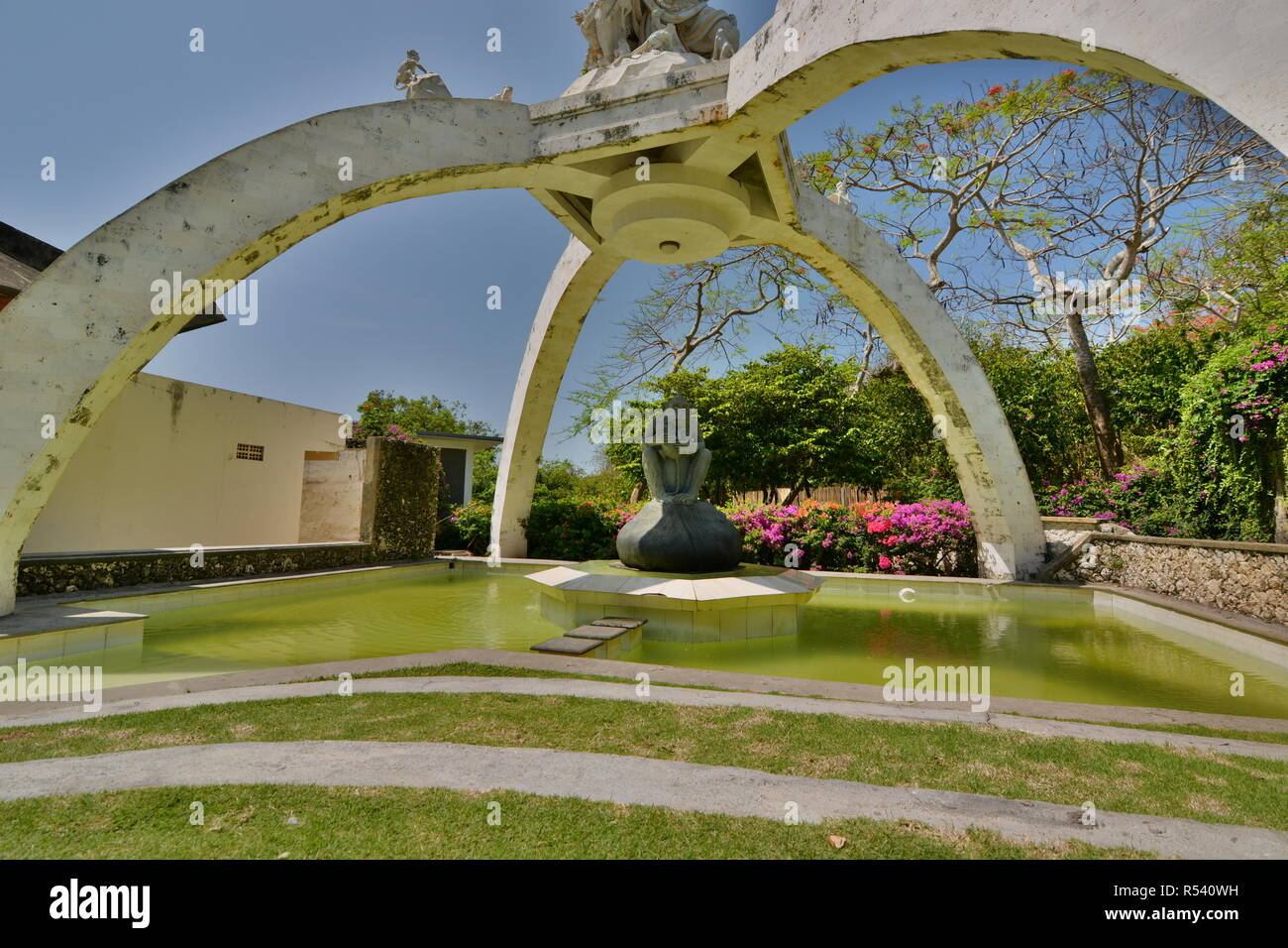 Kumbhakarna Laga statue and fountain. Pura Luhur Uluwatu. Bali. Indonesia Stock Photo