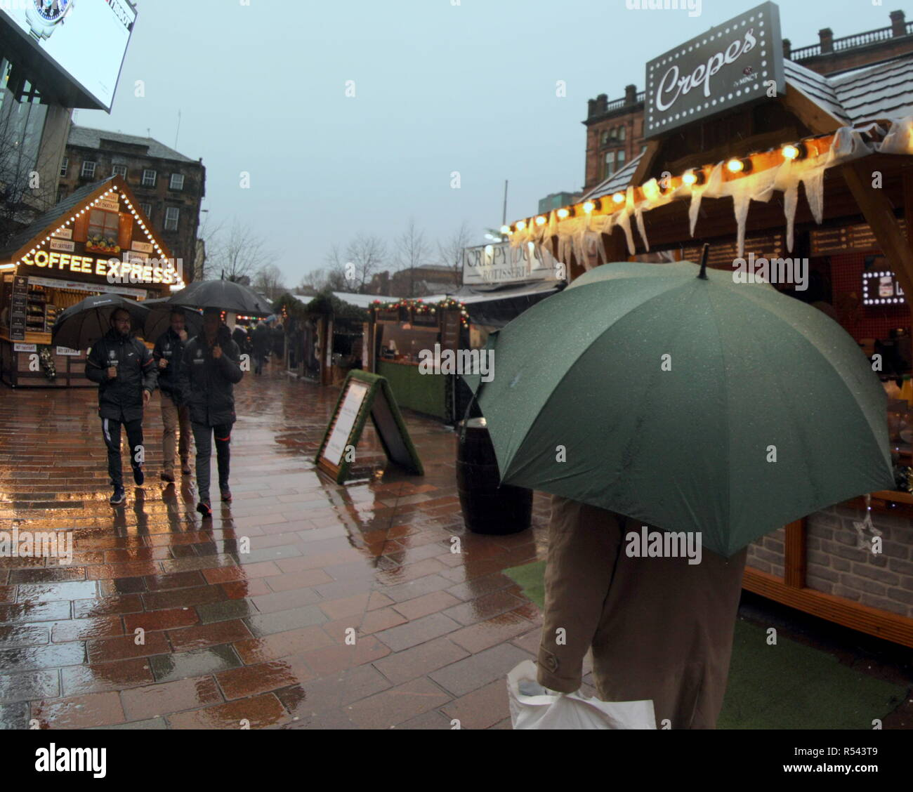 Glasgow, Scotland, UK. 29th Nov, 2018. UK Weather.Storm Diana weather warnings continue as the city gets very wet with heavy rain and locals are on the streets. Credit: gerard ferry/Alamy Live News Stock Photo