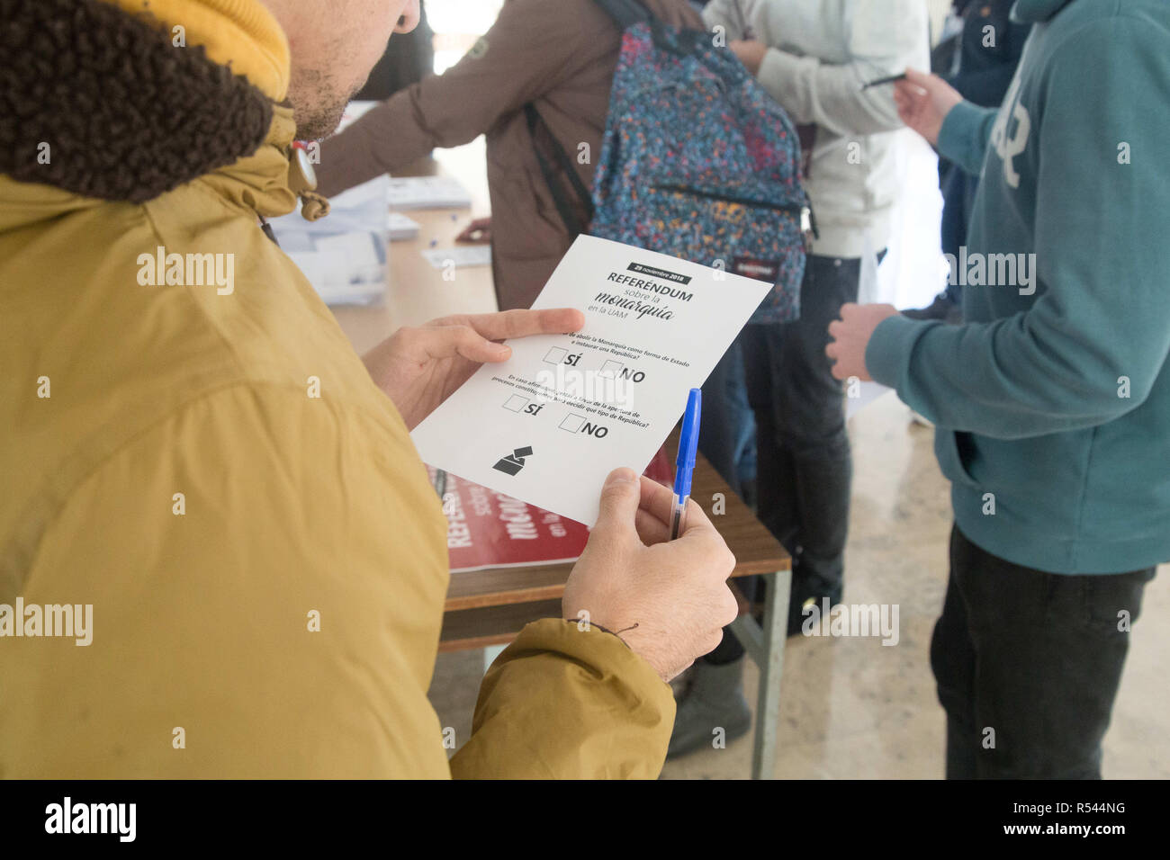 November 29, 2018 - Madrid, Spain - Student seen holding a ballot paper during the voting..Volunteers from the Autonomous University of Madrid initiated the consultative referendum to decide if the thousands of students, professors and workers of the university want a legitimate vote to decide the form of the Spanish state and ask if they prefer monarchy or republic. This vote would mark the first voting date that would be extended to other Spanish universities and Spanish cities. (Credit Image: © Lito Lizana/SOPA Images via ZUMA Wire) - Stock Image