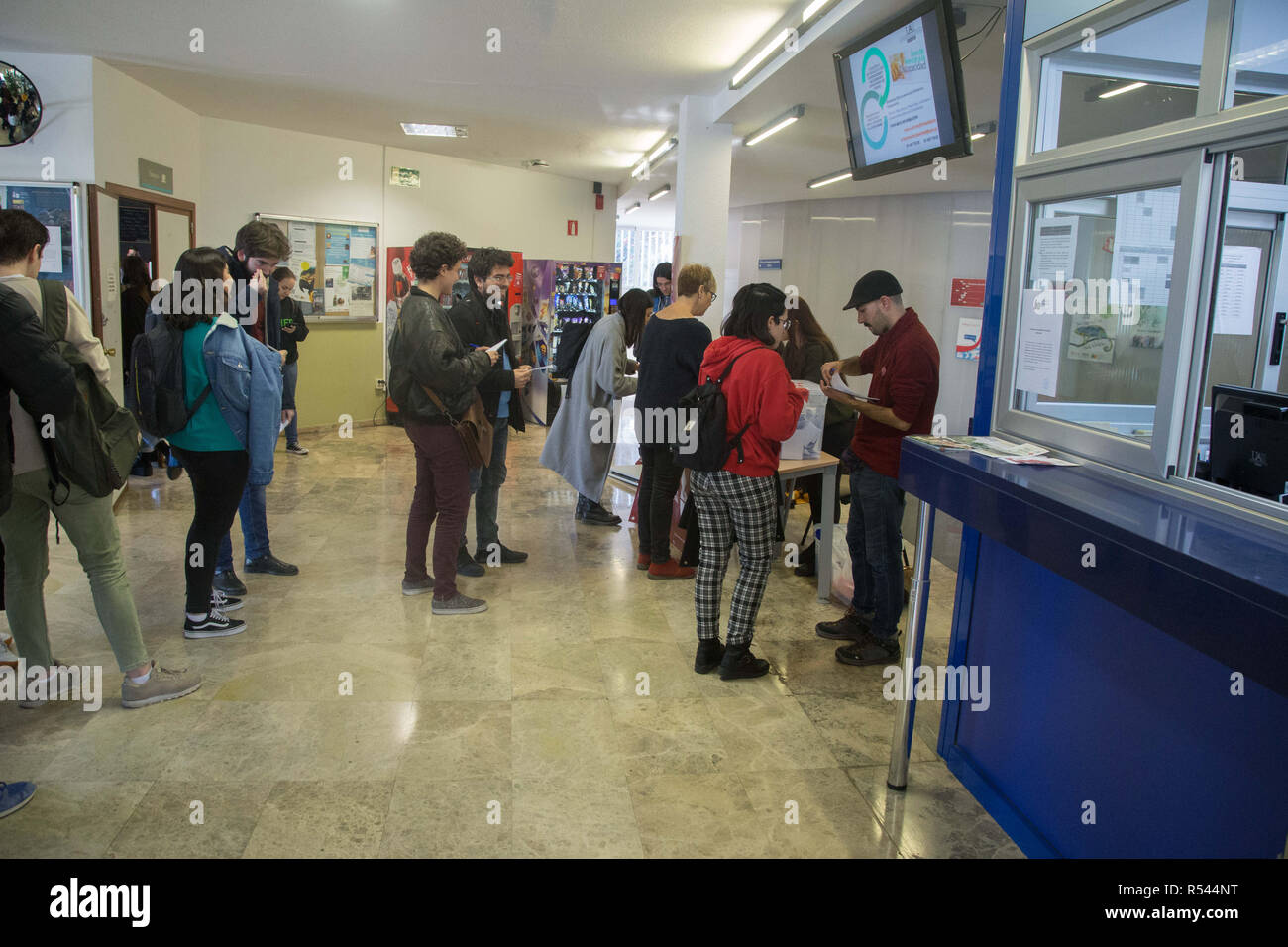 November 29, 2018 - Madrid, Spain - Students seen queuing up to vote during the referendum at the Faculty of Business..Volunteers from the Autonomous University of Madrid initiated the consultative referendum to decide if the thousands of students, professors and workers of the university want a legitimate vote to decide the form of the Spanish state and ask if they prefer monarchy or republic. This vote would mark the first voting date that would be extended to other Spanish universities and Spanish cities. (Credit Image: © Lito Lizana/SOPA Images via ZUMA Wire) - Stock Image