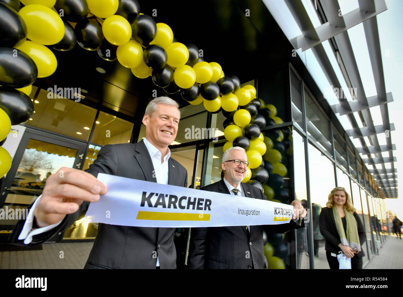 Karcher CR, a company specialising in the development, production and sales of cleaning devices, saw its sales rise by 15 percent to Kc592.3m last year, its net profit growing by 11.5 percent to Kc39.9m, company executive Milada Skutilova, not pictured, told in Prague, Czech Republic, November 29, 2018. Karcher CR today opened its new seat in Modletice near Prague, the construction of which has cost Kc140m. From left HARTMUT JENNER and JOHANNES KARCHER. (CTK Photo/Vit Simanek) - Stock Image