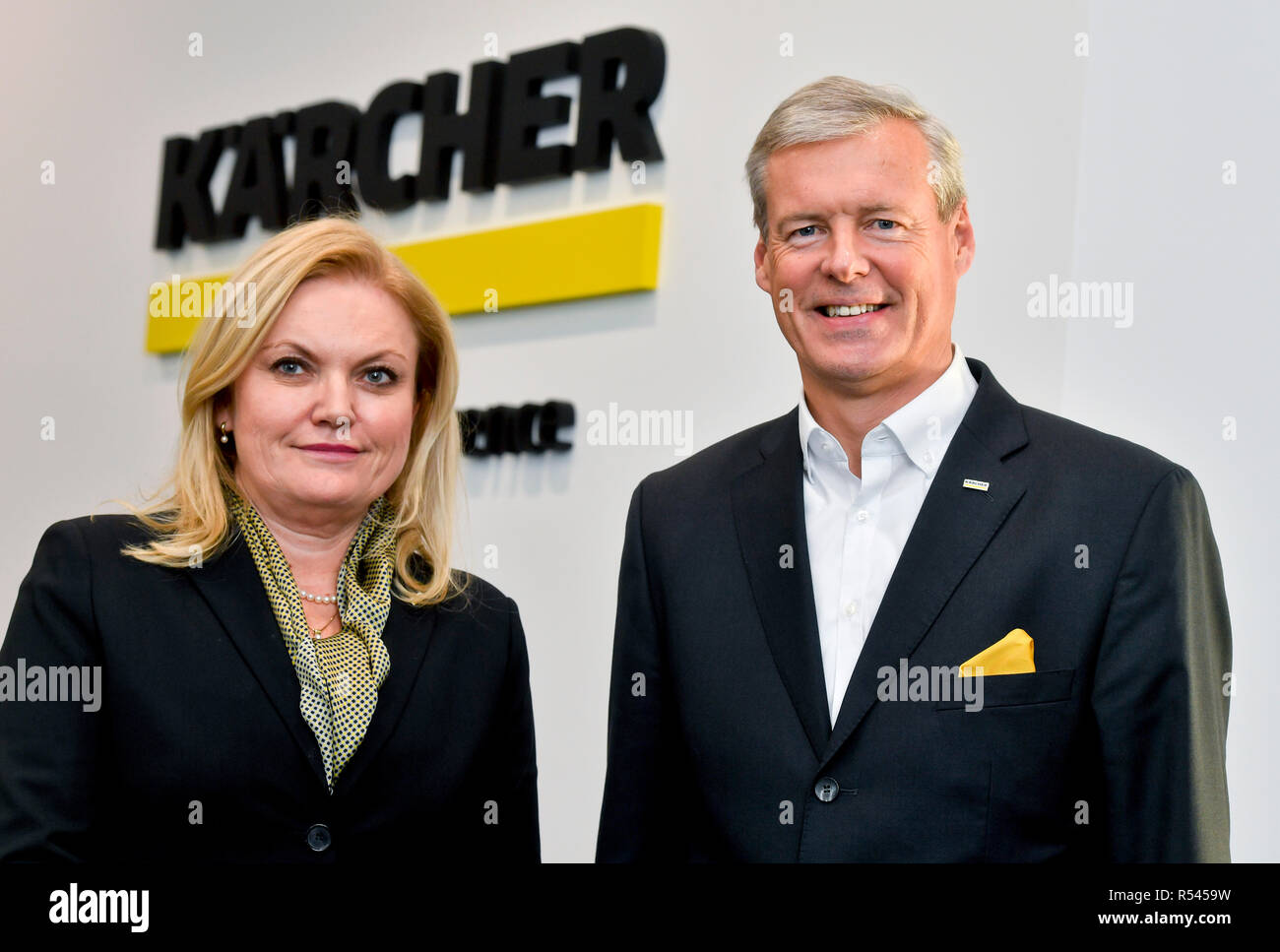 Karcher CR, a company specialising in the development, production and sales of cleaning devices, saw its sales rise by 15 percent to Kc592.3m last year, its net profit growing by 11.5 percent to Kc39.9m, company executive Milada Skutilova, left, told in Prague, Czech Republic, November 29, 2018. Karcher CR today opened its new seat in Modletice near Prague, the construction of which has cost Kc140m. At right is HARTMUT JENNER. (CTK Photo/Vit Simanek) - Stock Image