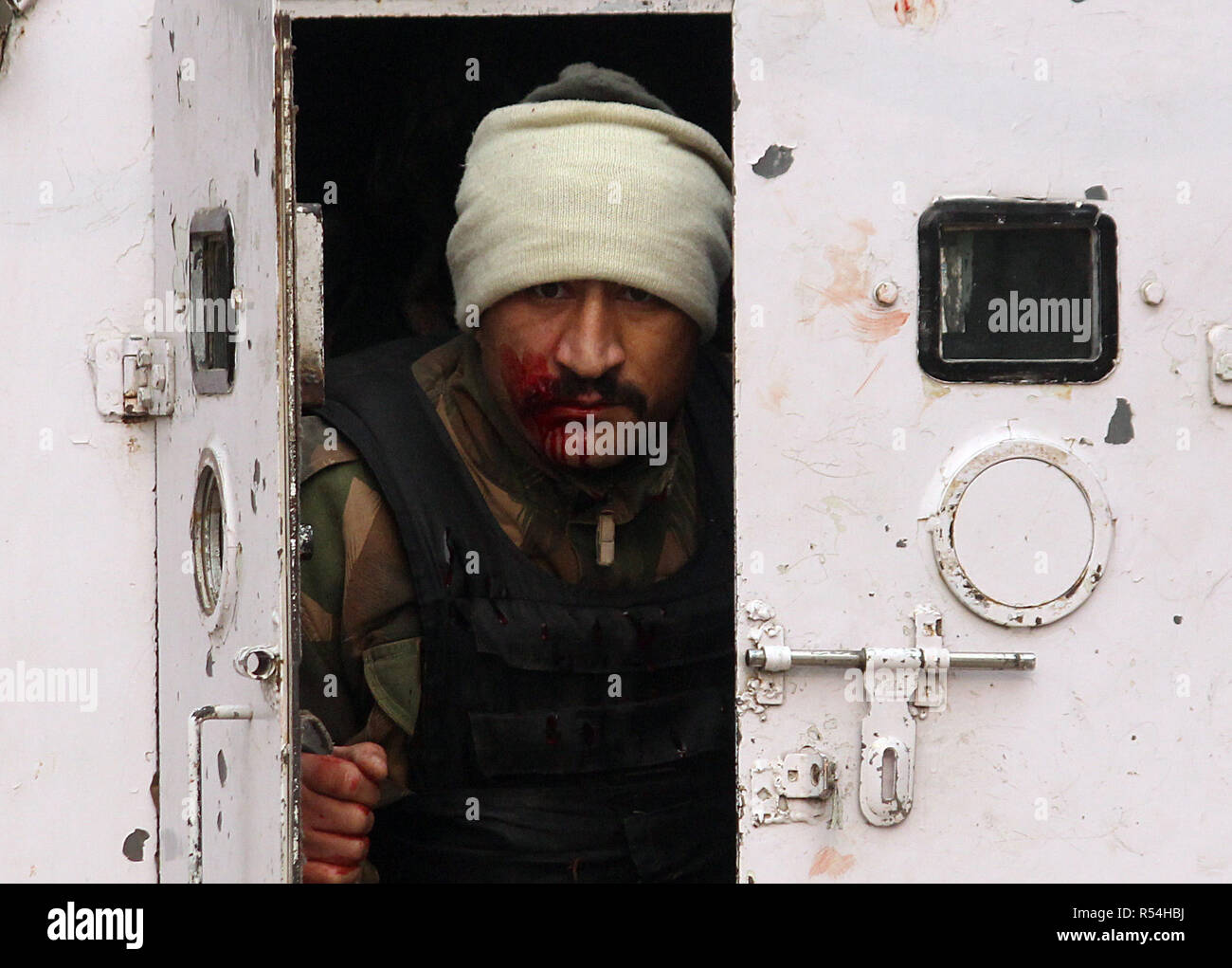 An Injured Indian soldier is seen inside the armoed vehicle