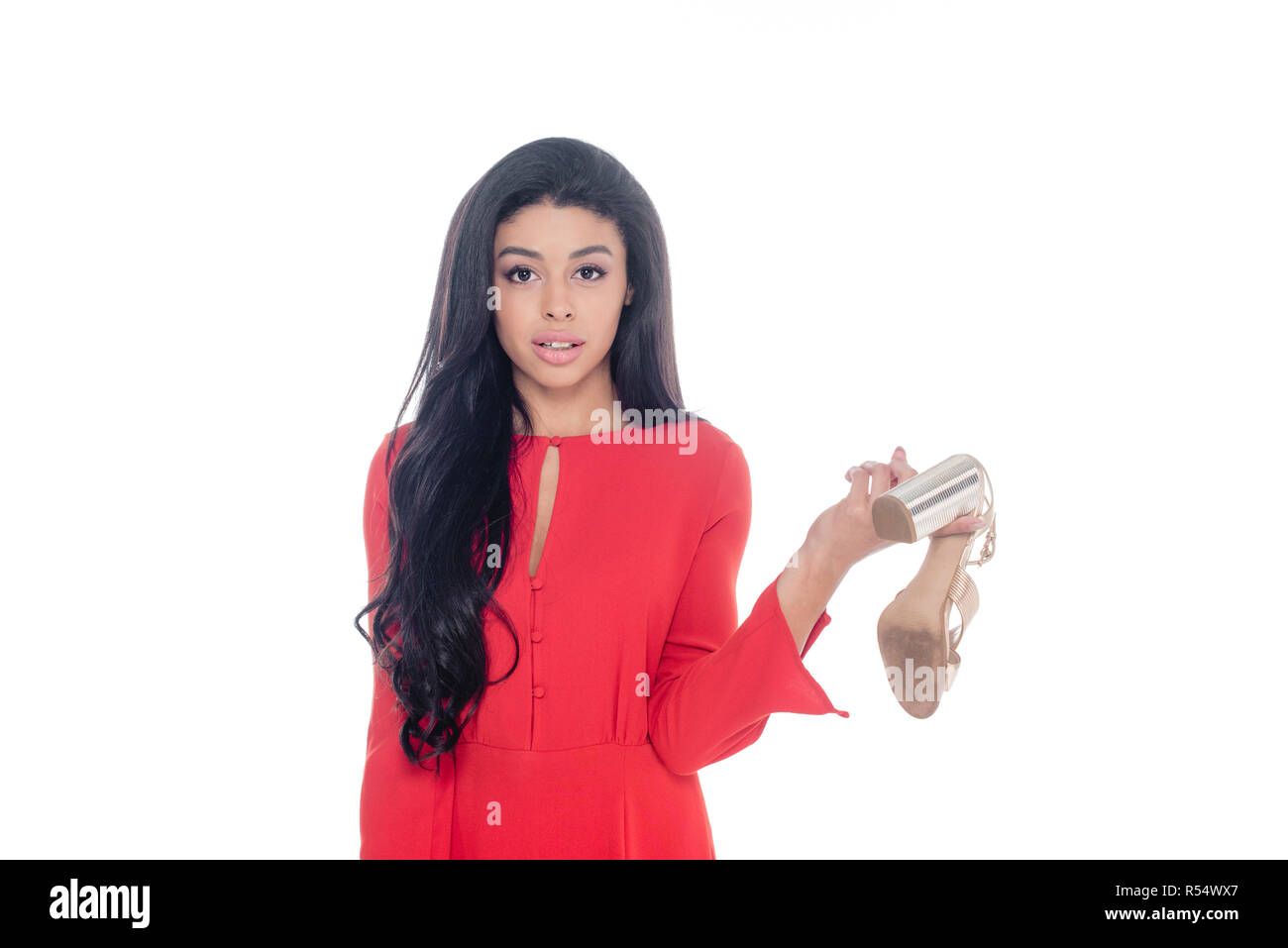 fa297bf9aed1 african american girl in red dress holding sandals with heels isolated on  white