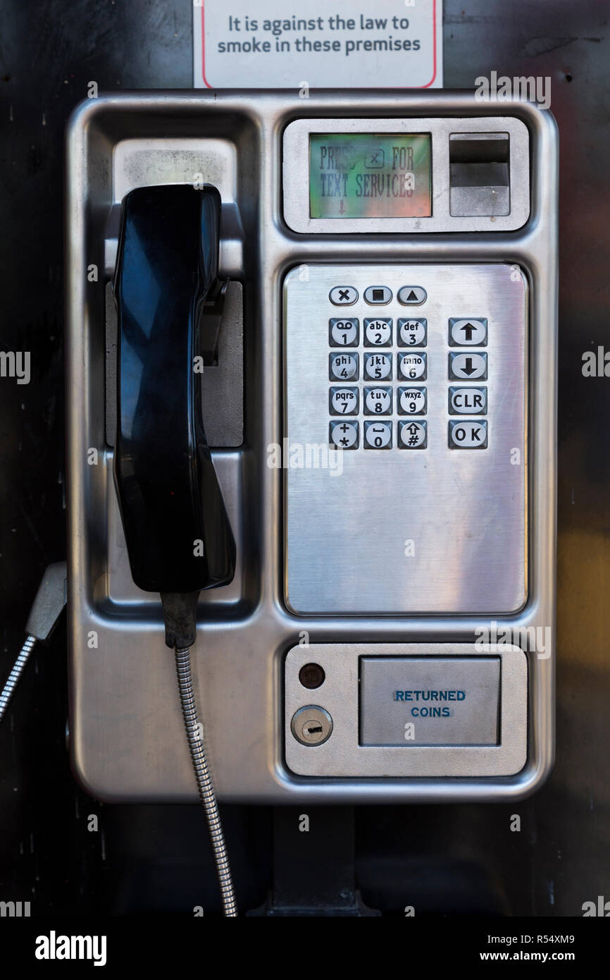 Late model BT British Telecom pushbutton / push button pay phone payphone in stainless steel which accepts coin / cash payment for phone calls. UK (98) - Stock Image