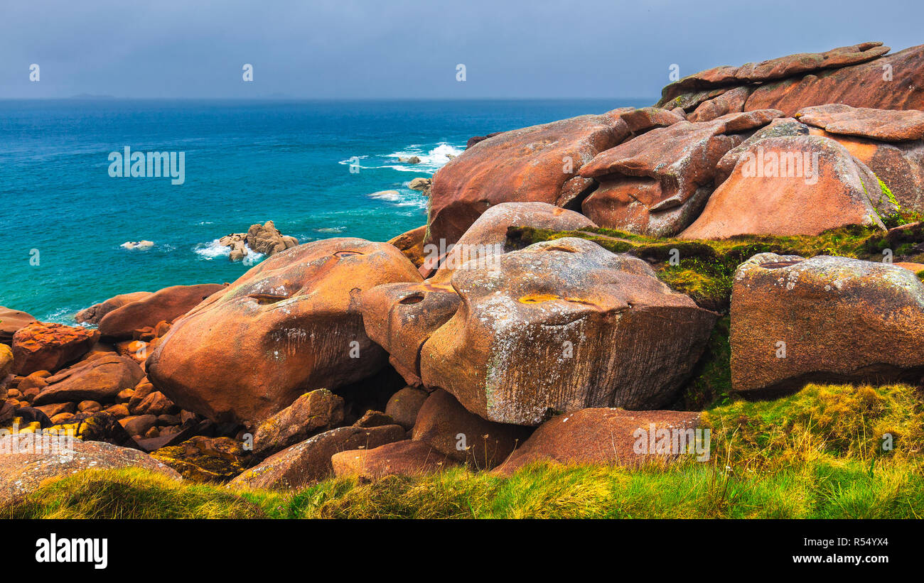 The pink granite rocks with strange shapes, coast in Brittany. The mass of enormous pink rocks, the pink granite, rock with strange shapes. Brittany ( Stock Photo