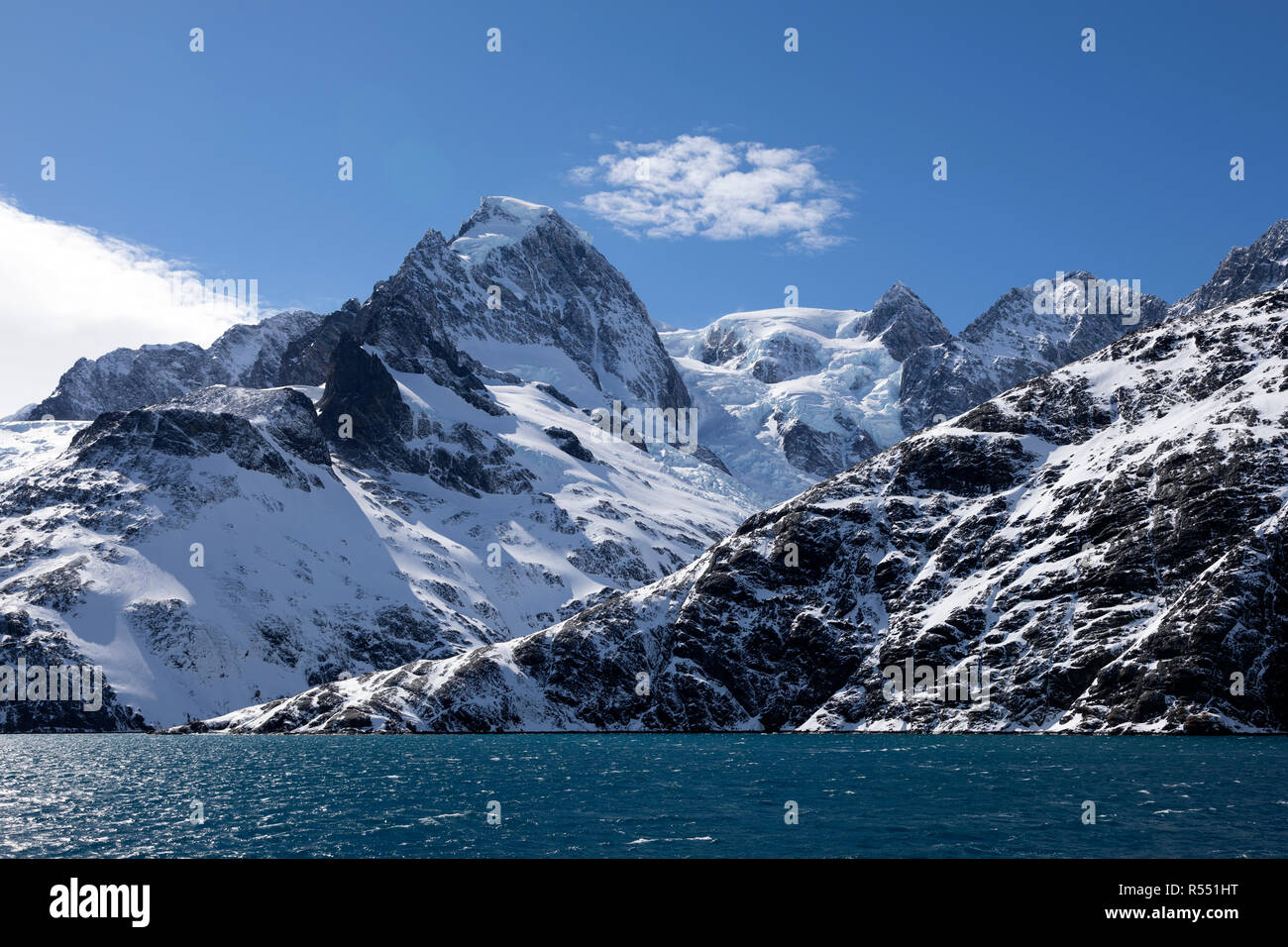 View of the spectacular Drygalski Fjord with snow covered mountains on South Georgia Island in the South Atlantic Island, Antarctica Stock Photo