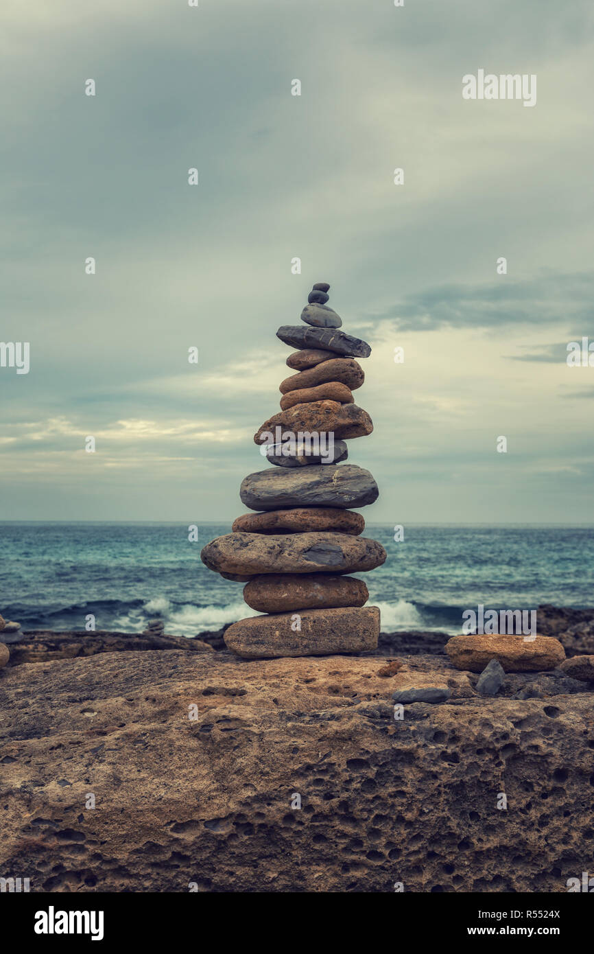 Small tower of stones on the coast Stock Photo