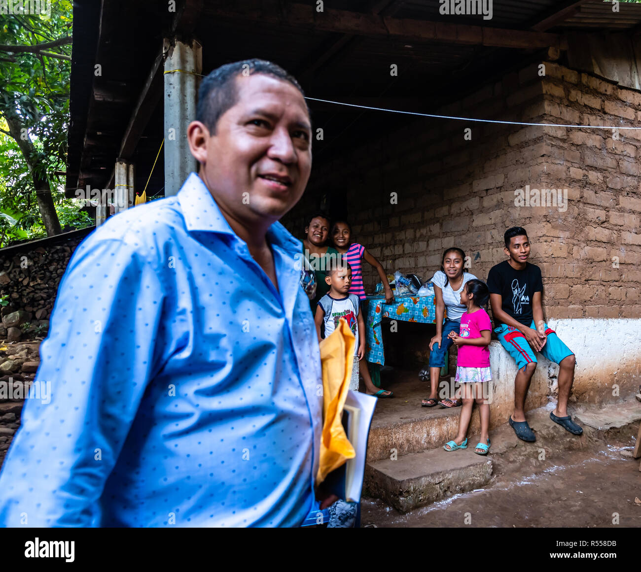 christian missionaries giving food and supplies to small village in Guatemalan jungle - Stock Image