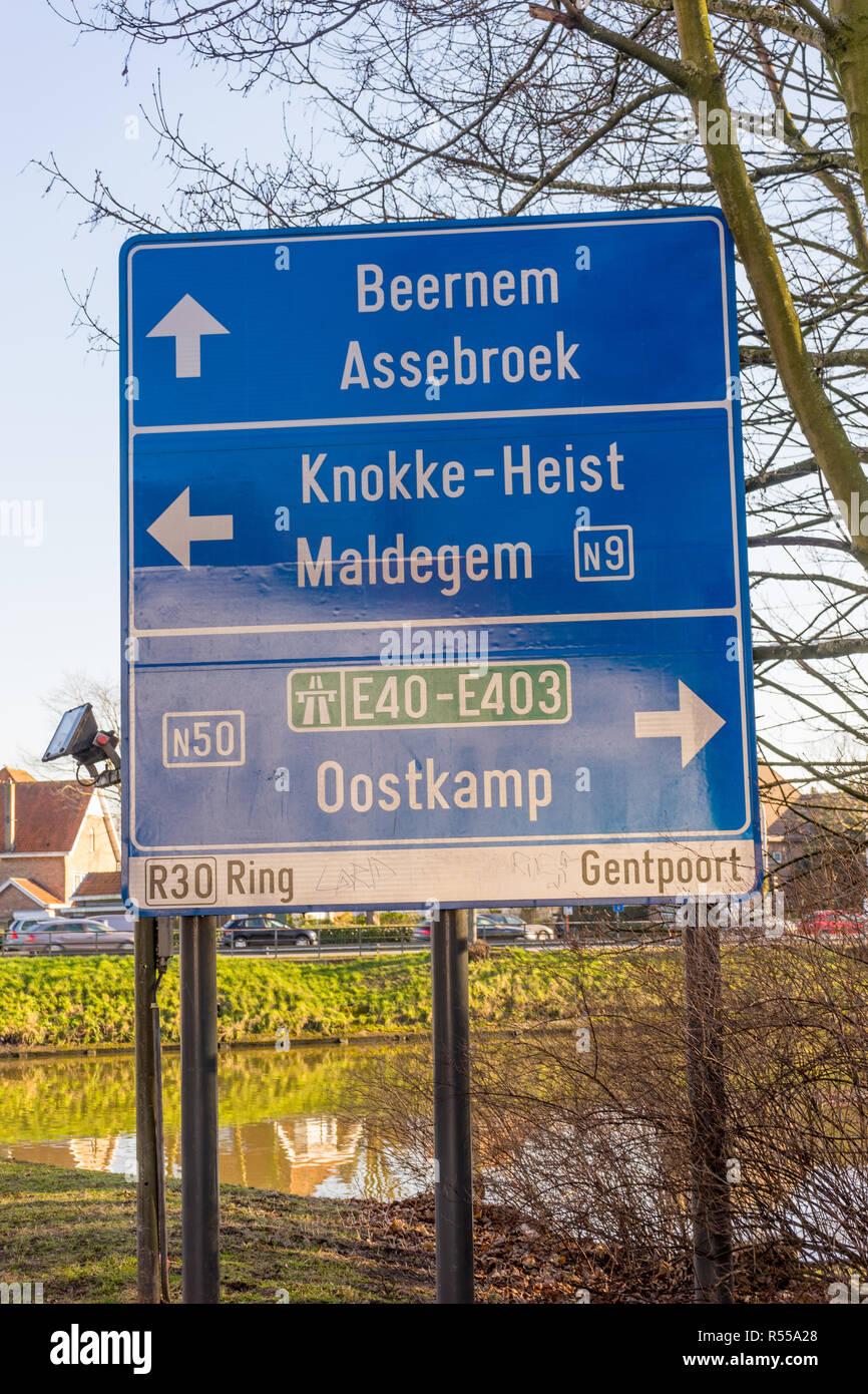 Bruges, Belgium - 17 February 2018:a close up of a sign in Brugge/Bruges Belgium showing Gentpoort, Oostkamp, Maldegem, Knokke-Heist, Assebroek and Be Stock Photo