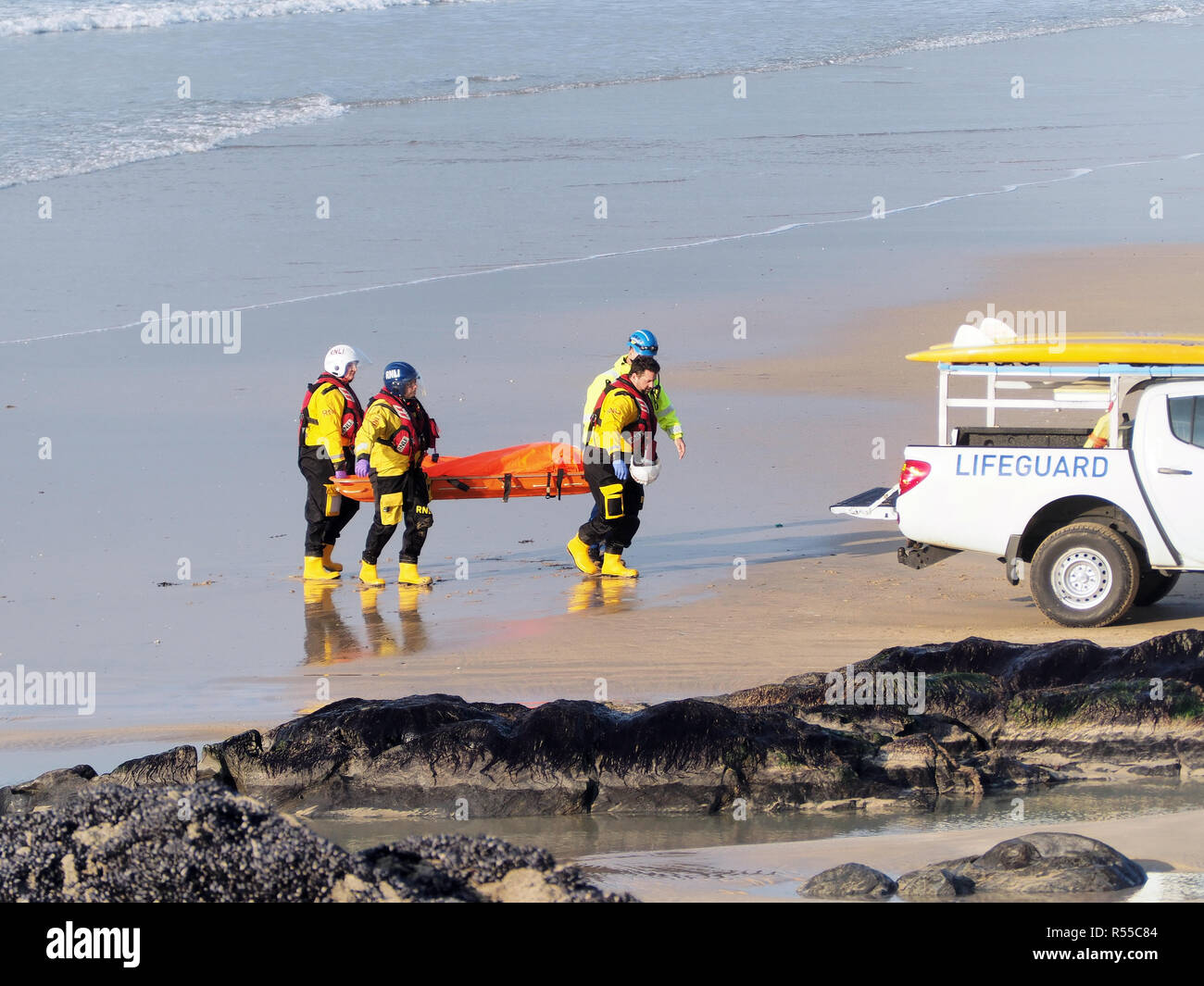 RNLI recovers dead body of Dylan Henty at Fistral Bay Newquay Cornwall UK - Stock Image