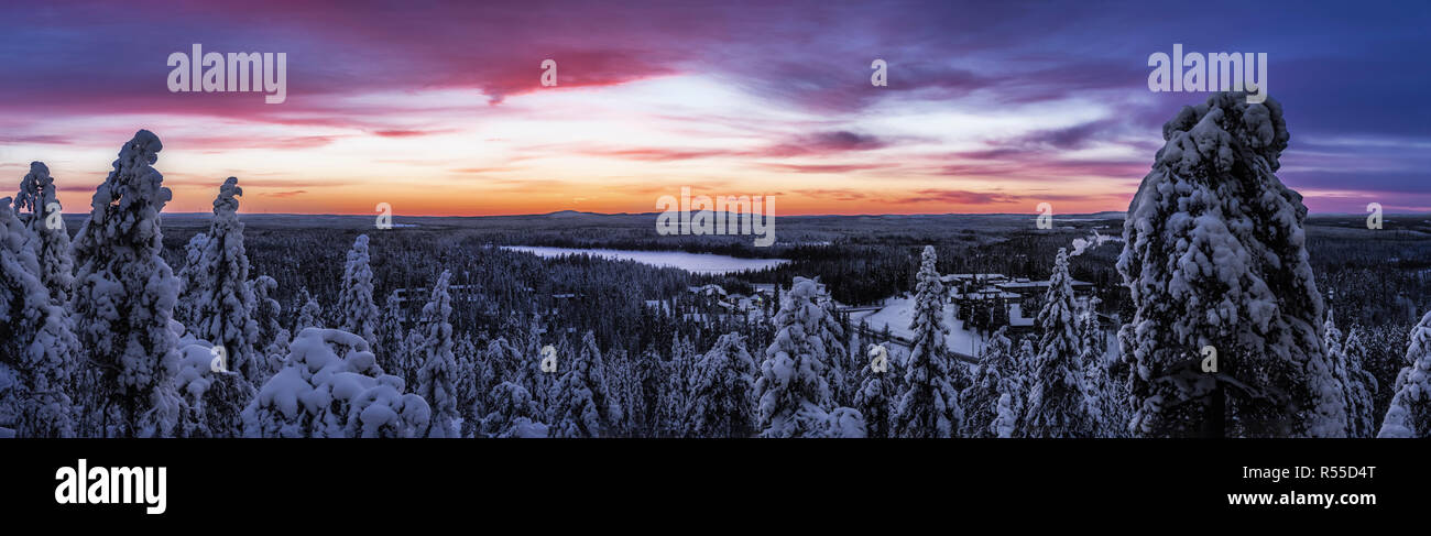 Ruka valley in Finnish Lapland, the gloam settles with spectacular skies and the famous 'Blue moment' - Stock Image