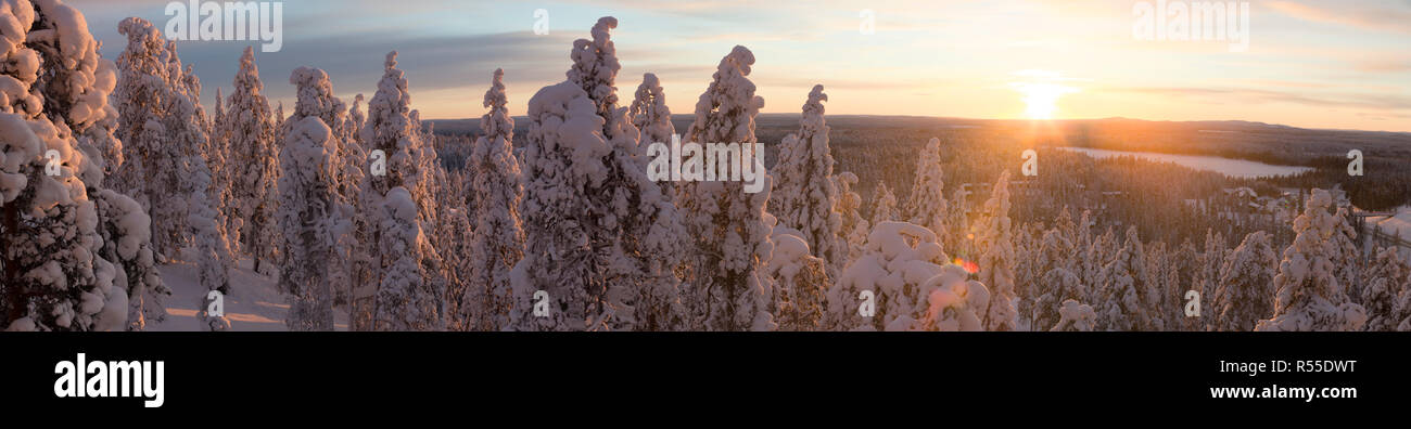 The winter sun starting to set over Ruka valley. - Stock Image