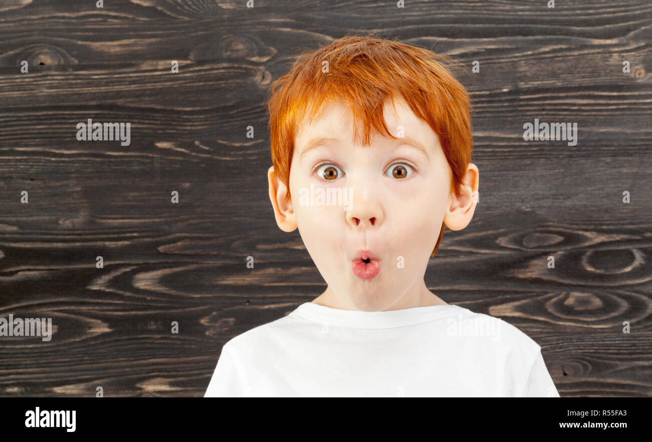 portrait of a surprised child with red hair 117d63026711
