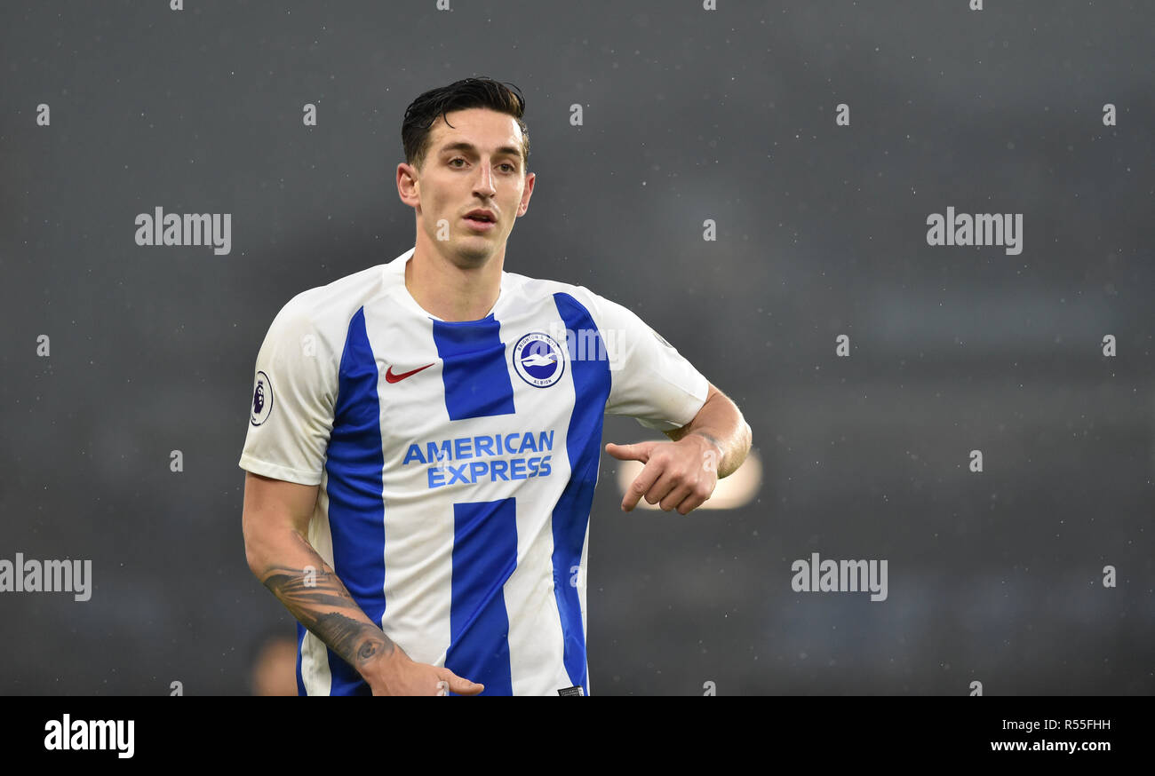 Lewis Dunk of Brighton during the Premier League match between Brighton and Hove Albion and Leicester City at American Express Community Stadium , Brighton , 24 November 2018 Editorial use only. No merchandising. For Football images FA and Premier League restrictions apply inc. no internet/mobile usage without FAPL license - for details contact Football Dataco Editorial use only. No merchandising. For Football images FA and Premier League restrictions apply inc. no internet/mobile usage without FAPL license - for details contact Football Dataco - Stock Image