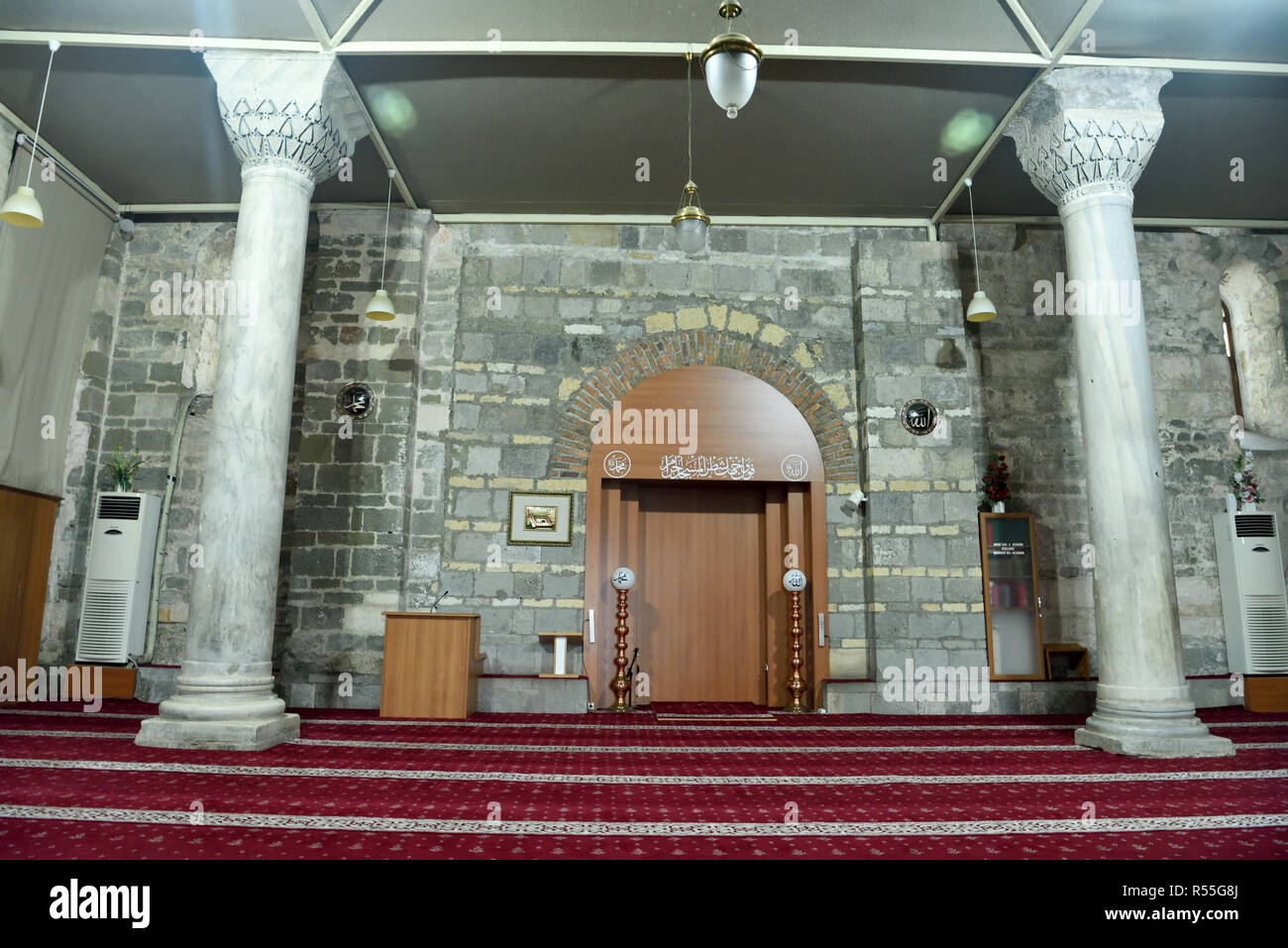 Interior View Of Aya Sofya Mosque In Trabzon, Turkey, With Two Columns,  Furniture And Arabic Inscriptions.