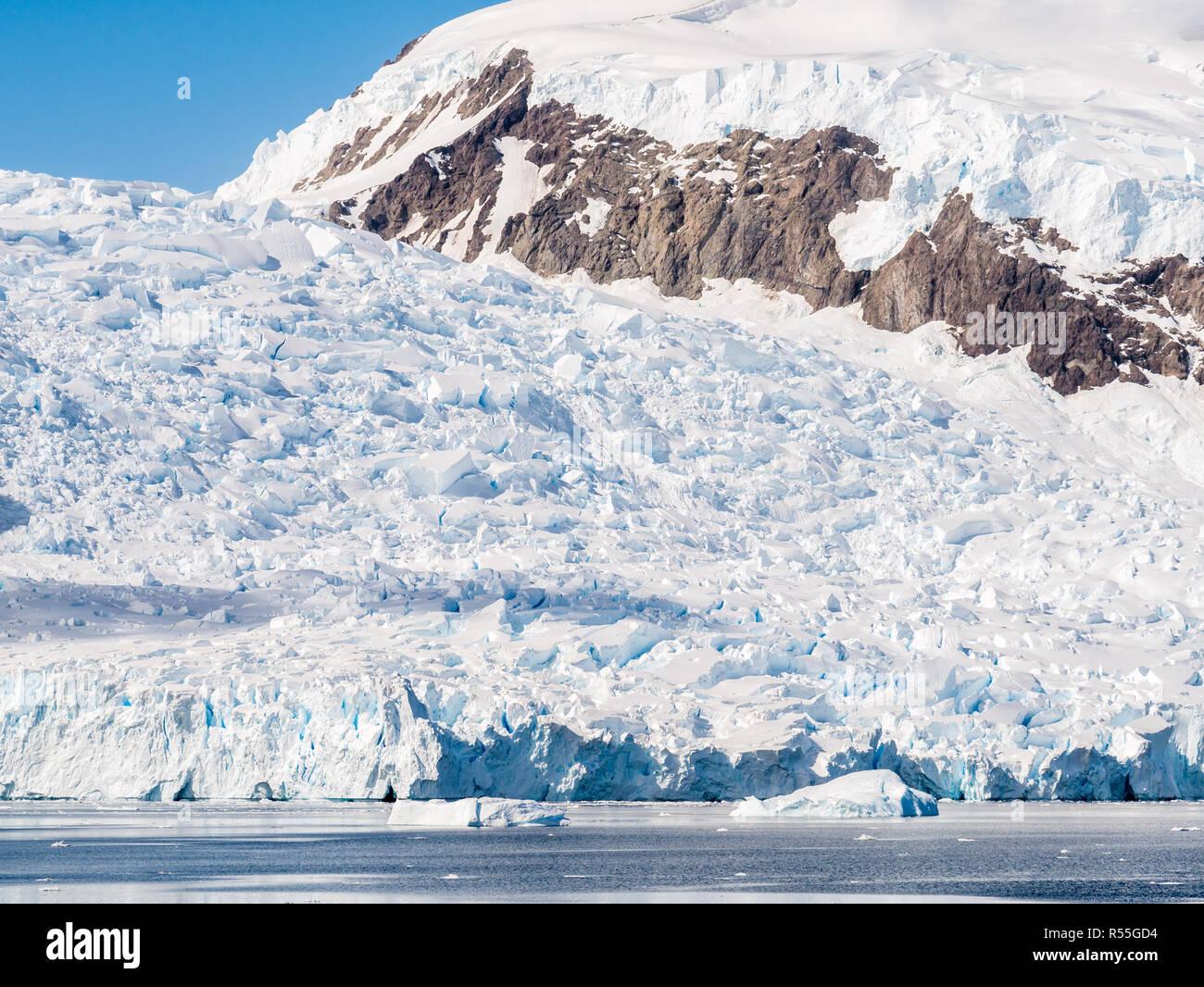 Deville glacier calving in Andvord Bay near Neko Harbour, Arctowski Peninsula, Antarctica - Stock Image