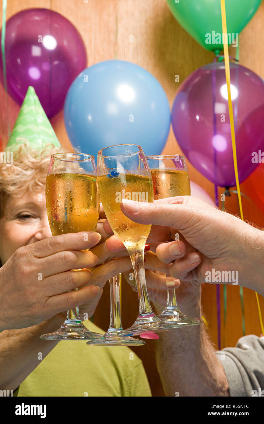 Senior adults at a party - Stock Image