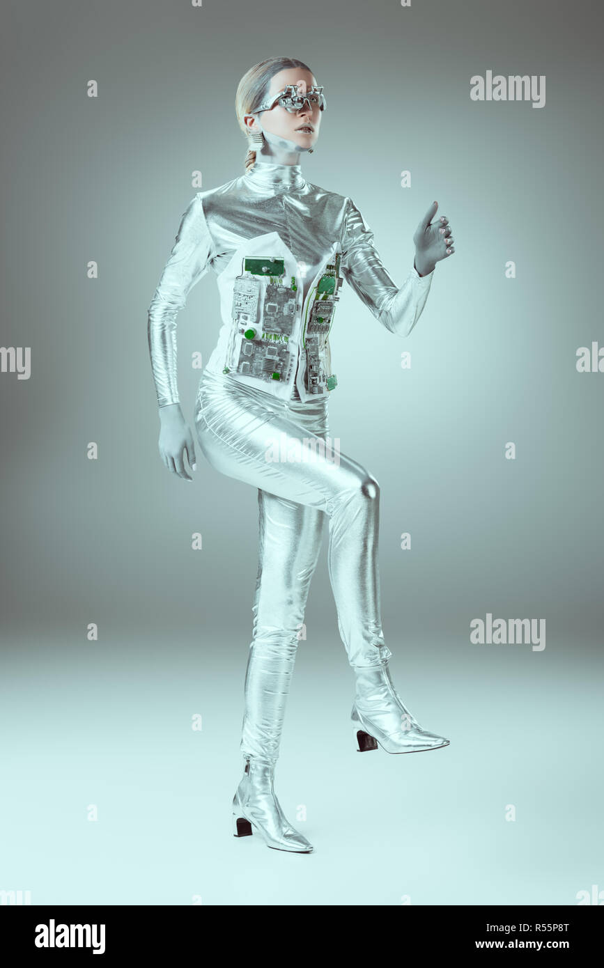 full length view of futuristic cyborg walking on grey, future technology concept - Stock Image