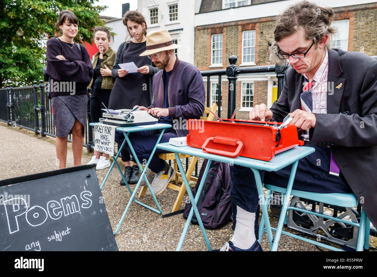 United Kingdom Great Britain England London Southwark Bankside street poets verse to go literary street artists spontaneous poets unusual occupation p - Stock Image