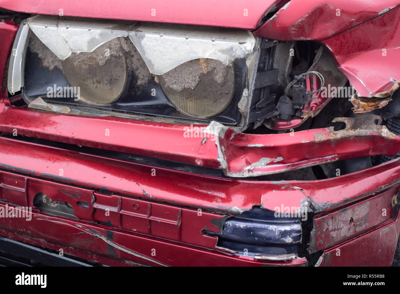 damaged car headlamp after accident, subject to insurance claim - Stock Image
