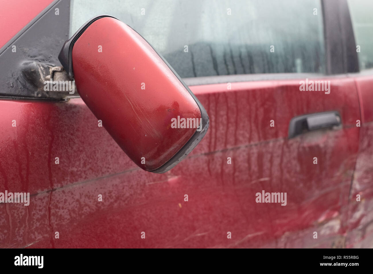 right car mirror broken after accident, subject to insurance claim - Stock Image