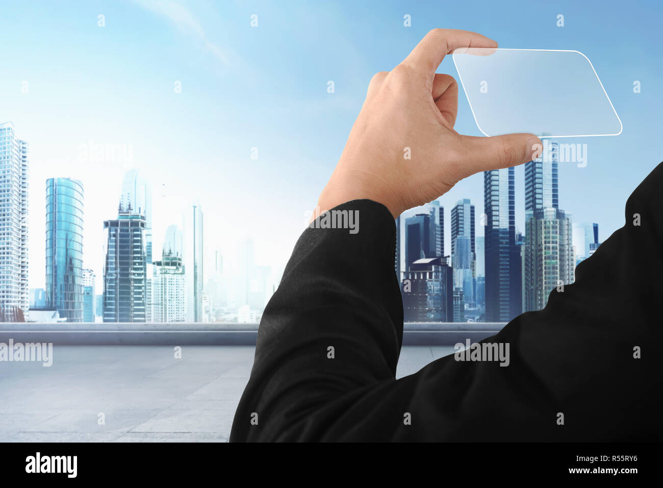 Business Hand Holding Futuristic Business Card Stock Photo