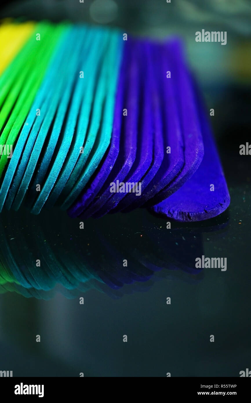 Rainbow abtract macro done with colorful wooden sticks - Stock Image