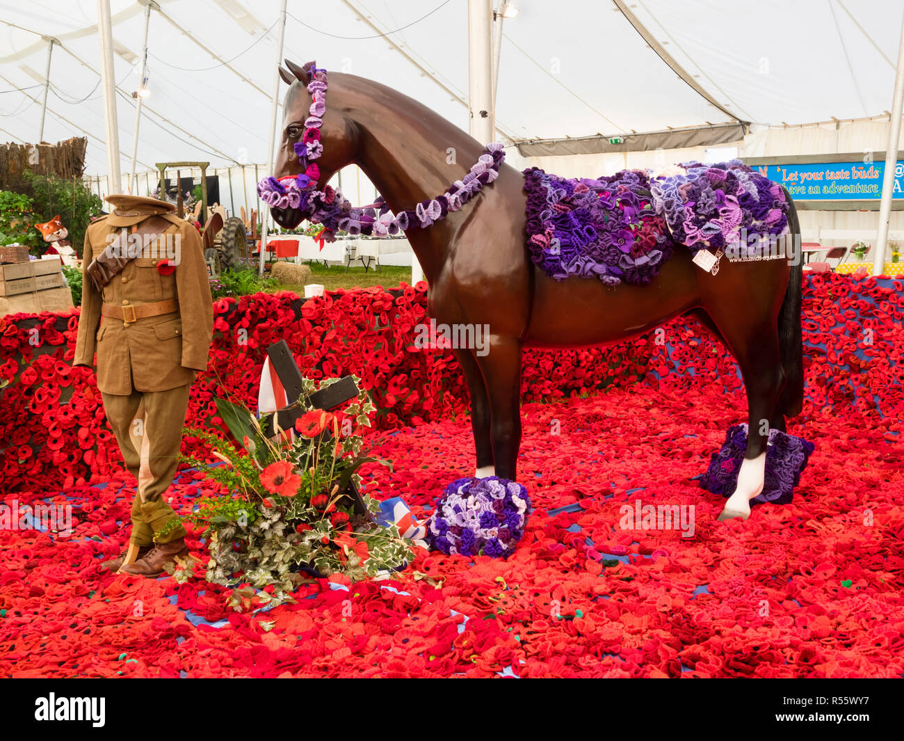 World War 1 remembrance memorial with horse and private models among knitted poppies at Devon County Show, 2018 - Stock Image